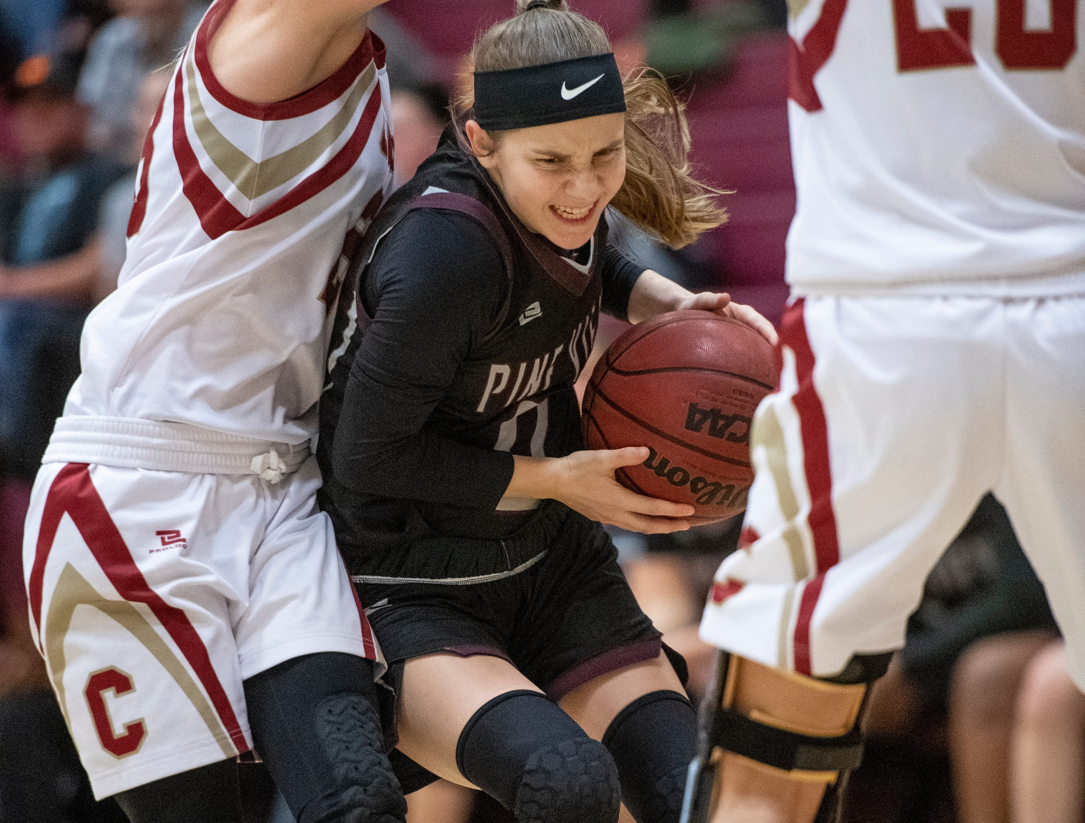 Pine View junior Sophia Jensen (0) is squished in the Cedar defense at CHS Tuesday, January 8, 2019. Cedar remains undefeated with a 63-40 win over the Panthers.