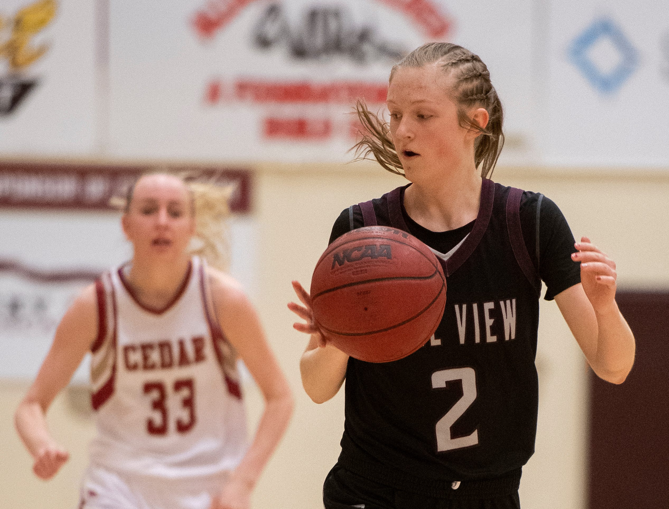 Pine View High School junior Ellie Wilson (2) moves the ball against Cedar High at CHS Tuesday, January 8, 2019. Cedar remains undefeated with a 63-40 win over the Panthers.