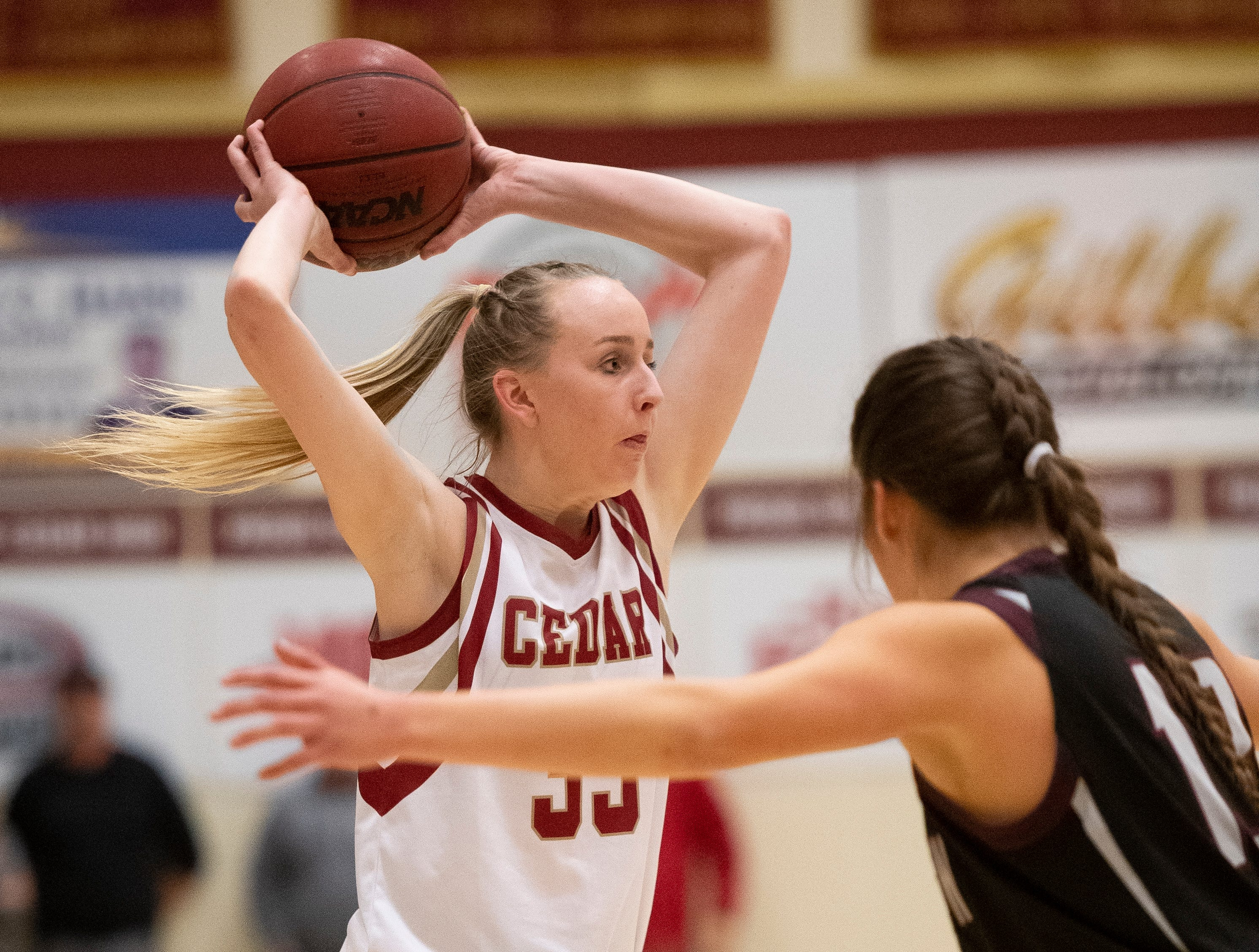 Cedar High School sophomore Samantha Johnston (33) throws a pass against Pine View at CHS Tuesday, January 8, 2019. Cedar remains undefeated with a 63-40 win over the Panthers.
