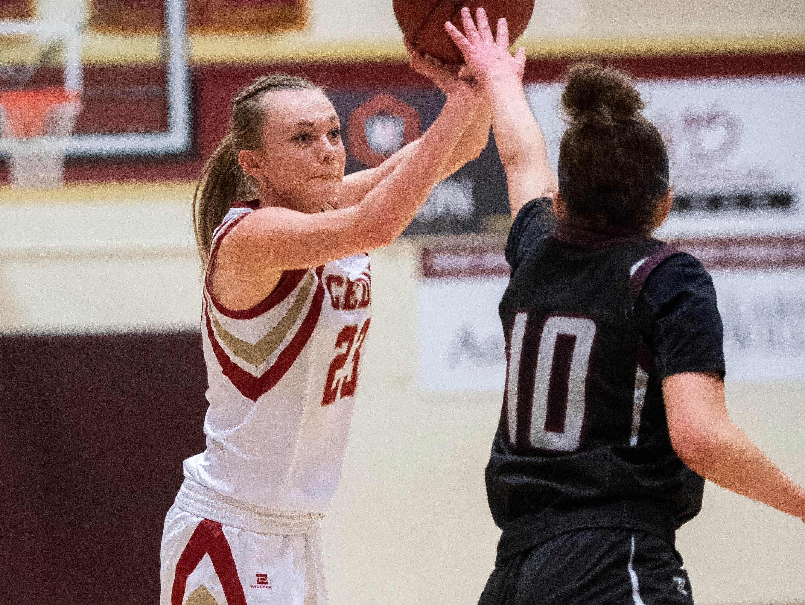 Cedar High School junior Mayci Torgerson (23) sinks a three-point basket against Pine View at CHS Tuesday, January 8, 2019. Cedar remains undefeated with a 63-40 win over the Panthers.