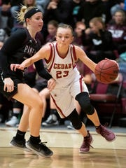 Cedar High School's Mayci Torgerson (23) was named Region 9's Most Valuable Player by Region 9 coaches this week. The entire Lady Red starting five garnered all-region honors.