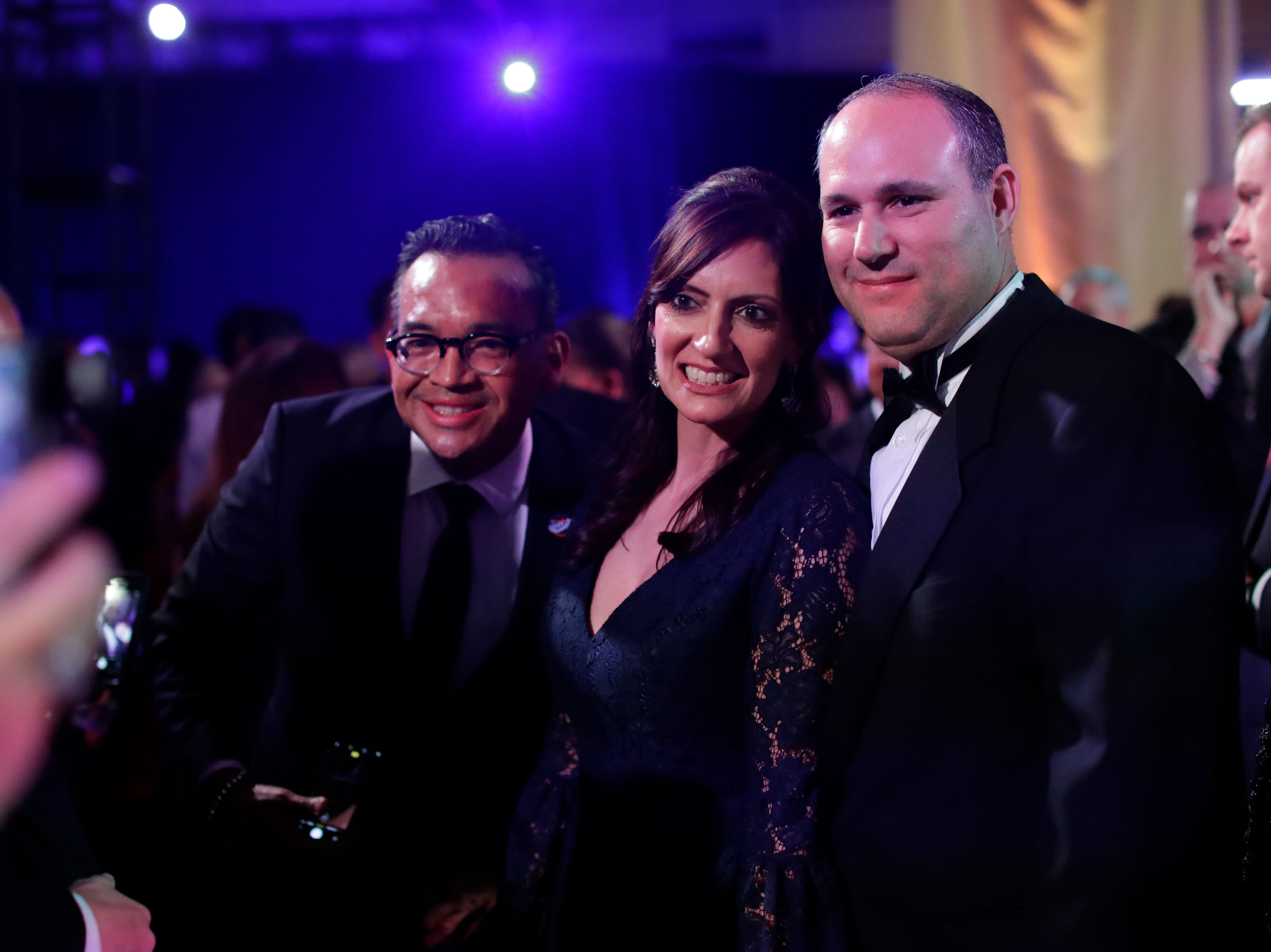 Hundreds of guests from all over Florida attend Florida's 46th Governor's Inaugural Ball at the Tucker Civic Center, Tuesday, Jan. 8, 2019. Lt. Gov. Jeanette Nunez, center, poses for a photo with her husband, Adrian Nunez, right, and a guest at the ball.