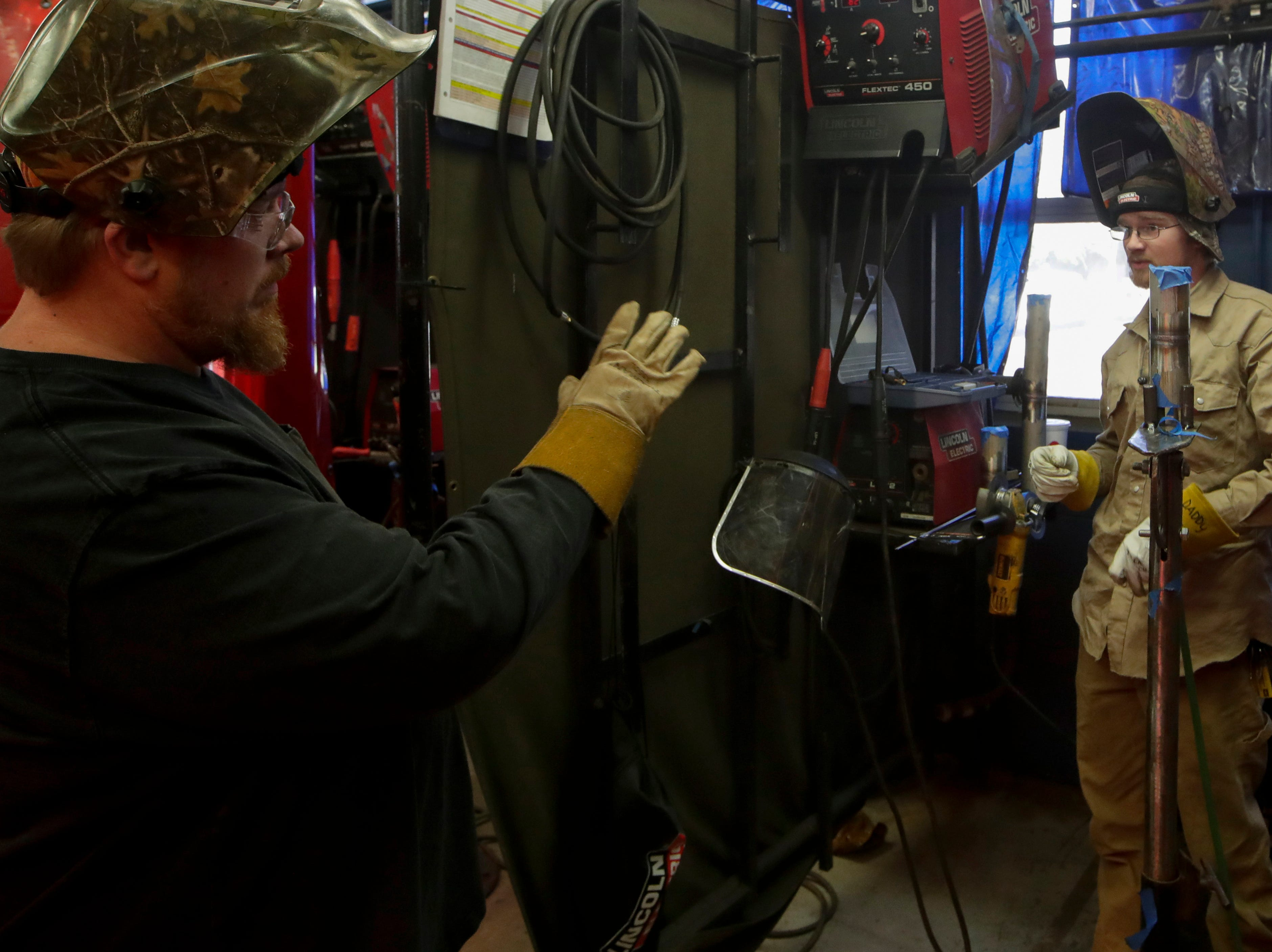 Advanced welding instructor Milford Sims talks with Hunter Bulls, an advanced welding student Wednesday, Jan. 9, 2019 at Lively Technical Center which has been approved by the Leon County School Board to change it's name to Lively Technical College.