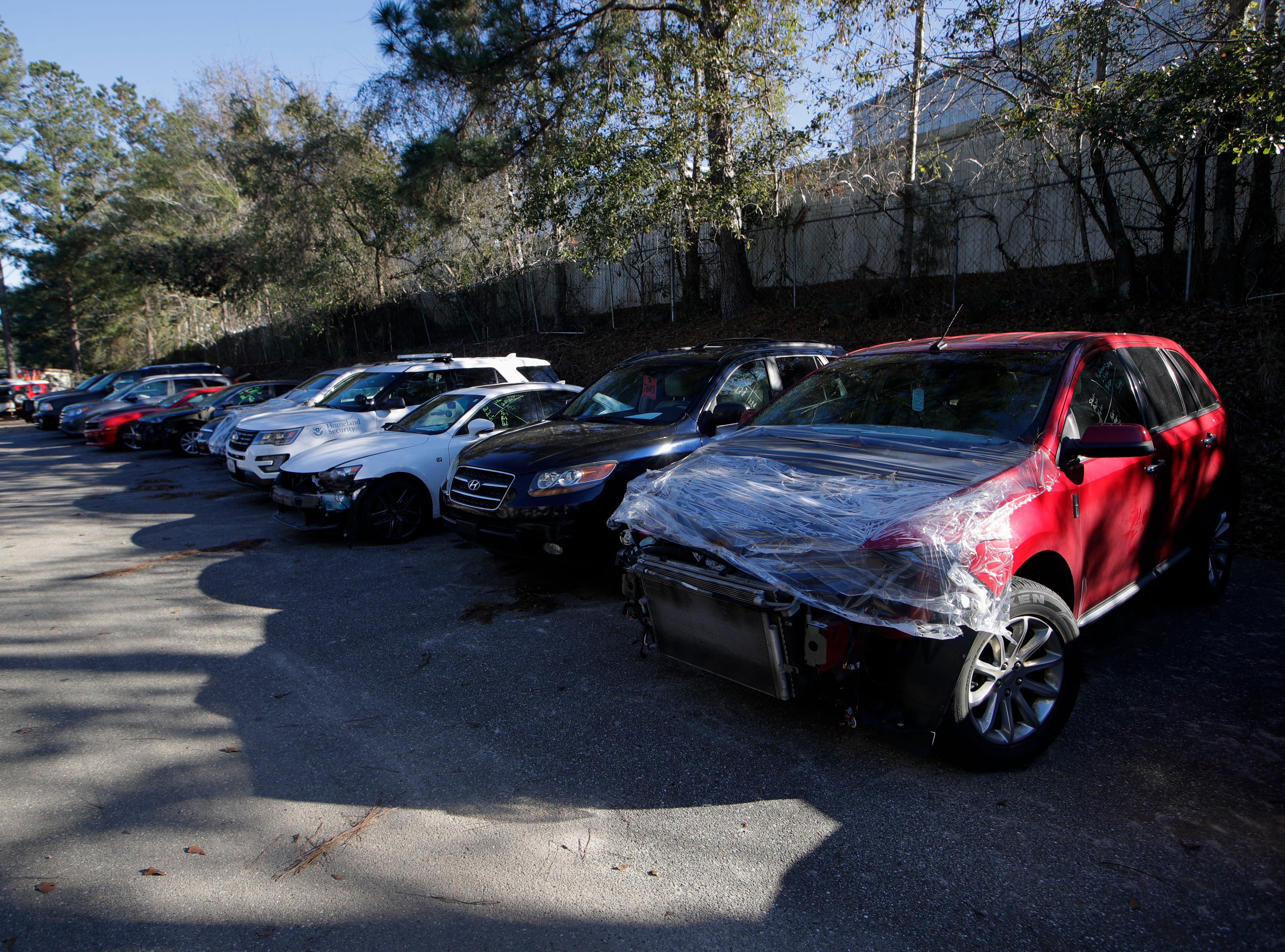 More than twenty cars are lined up behind Body Builders Paint and Body Inc. waiting to be repaired after Hurricane Michael in October has left the business with a backlog of work.