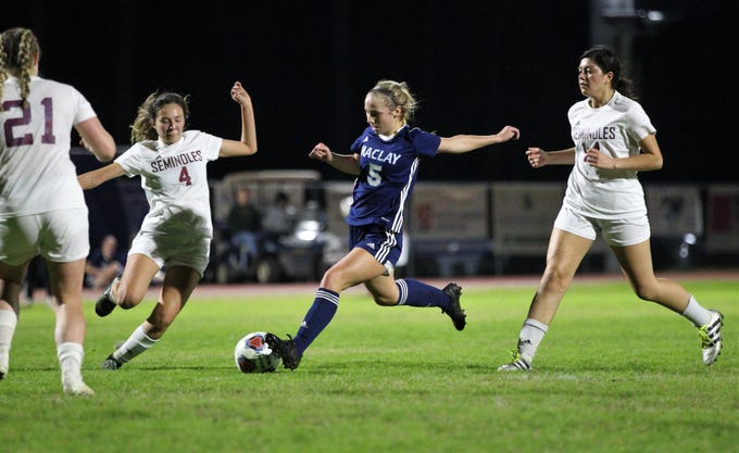 Maclay's Katelyn Dessi steps into a shot between Florida High's Daphne Cervantes (4) and Rubi Castro (14). The Marauders won 3-0 at home on Jan. 8, 2019.