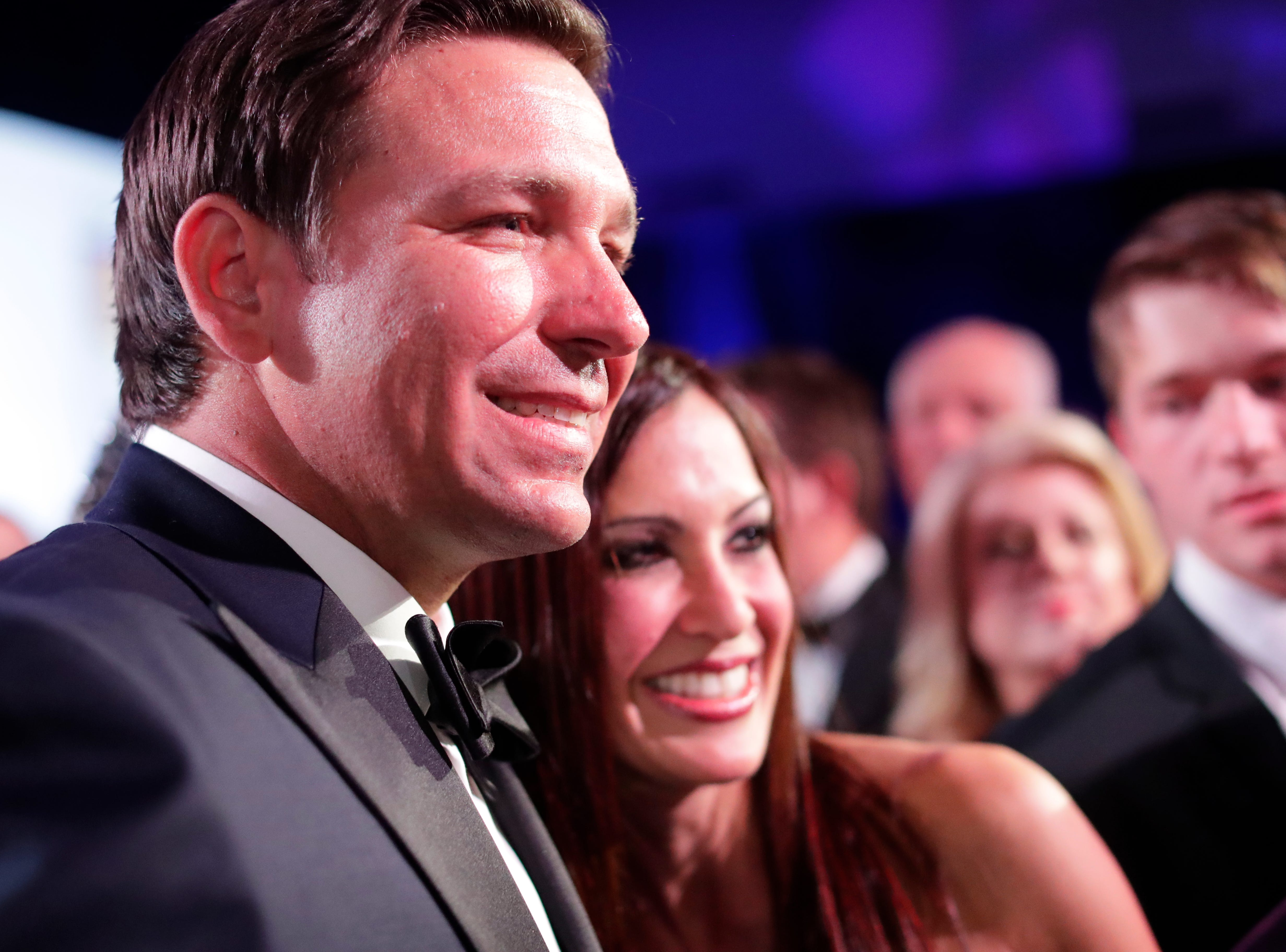 Hundreds of guests from all over Florida attend Florida's 46th Governor's Inaugural Ball at the Tucker Civic Center, Tuesday, Jan. 8, 2019. Gov. Ron DeSantis poses for a photo with a guest.