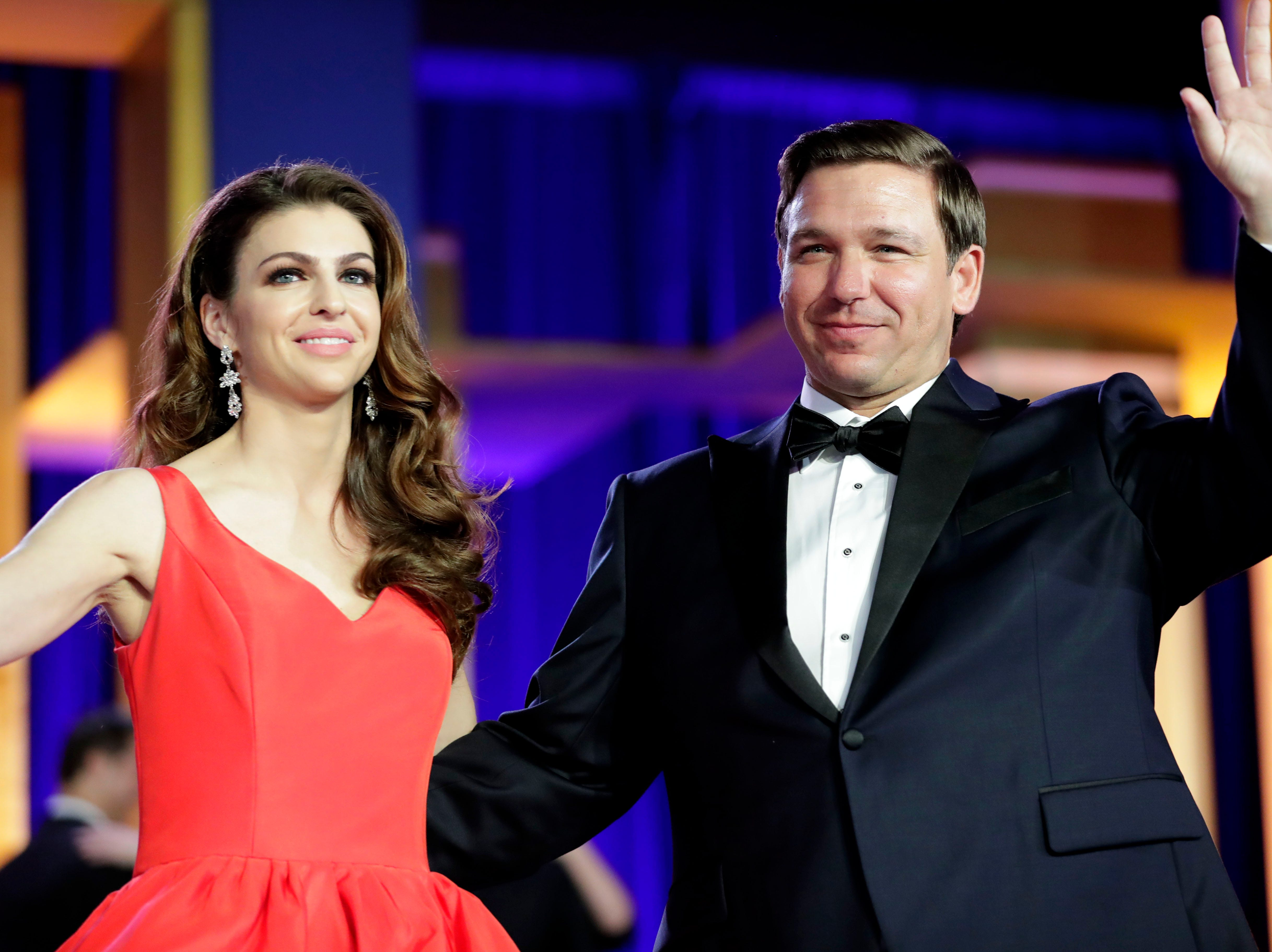 Hundreds of guests from all over Florida attend Florida's 46th Governor's Inaugural Ball at the Tucker Civic Center, Tuesday, Jan. 8, 2019. First lady Casey DeSantis and Gov. Ron DeSantis wave to the crowd after they finish dancing.