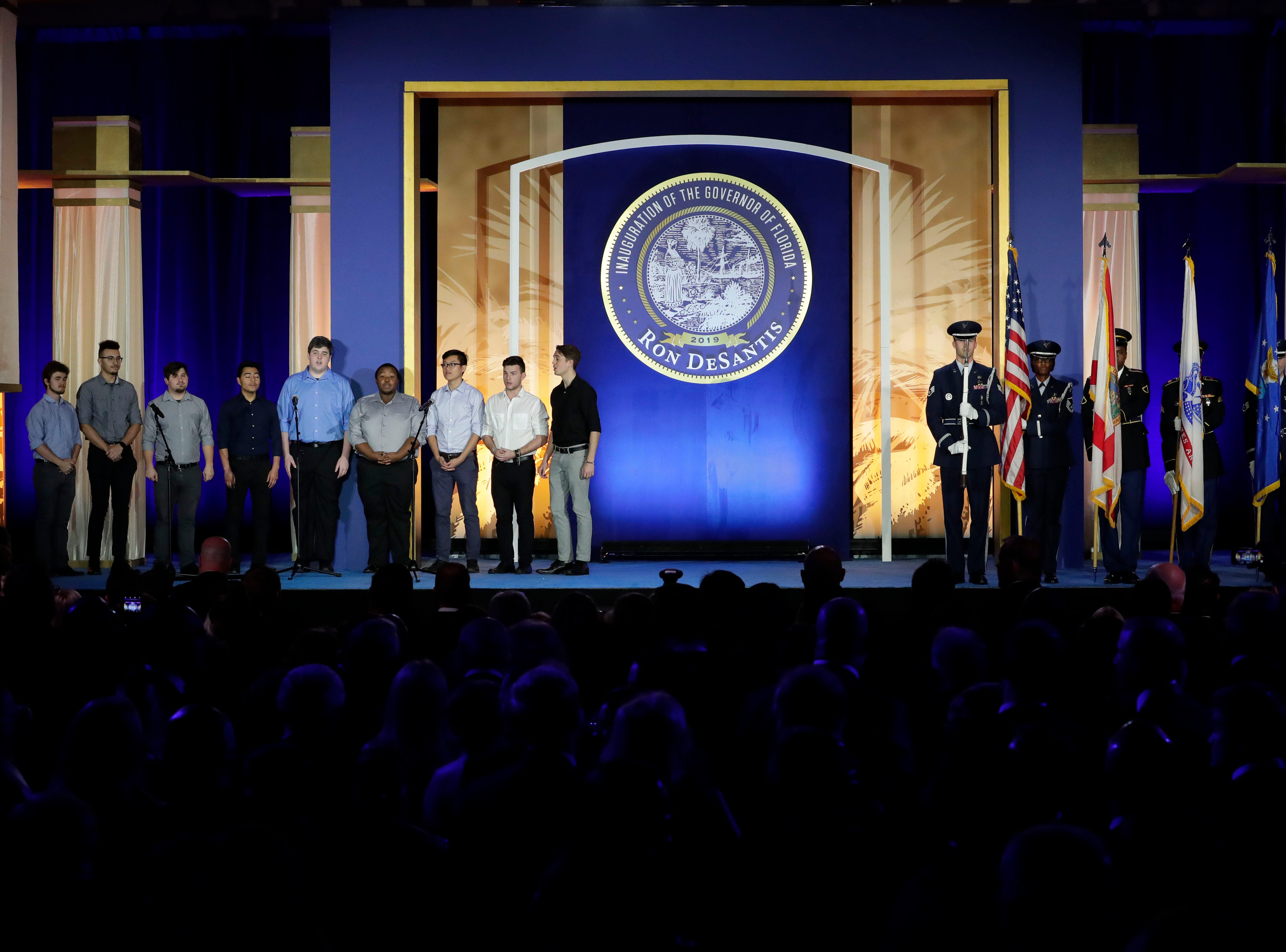 Hundreds of guests from all over Florida attend Florida's 46th Governor's Inaugural Ball at the Tucker Civic Center, Tuesday, Jan. 8, 2019. An a cappella boys group, left, performs the national anthem.