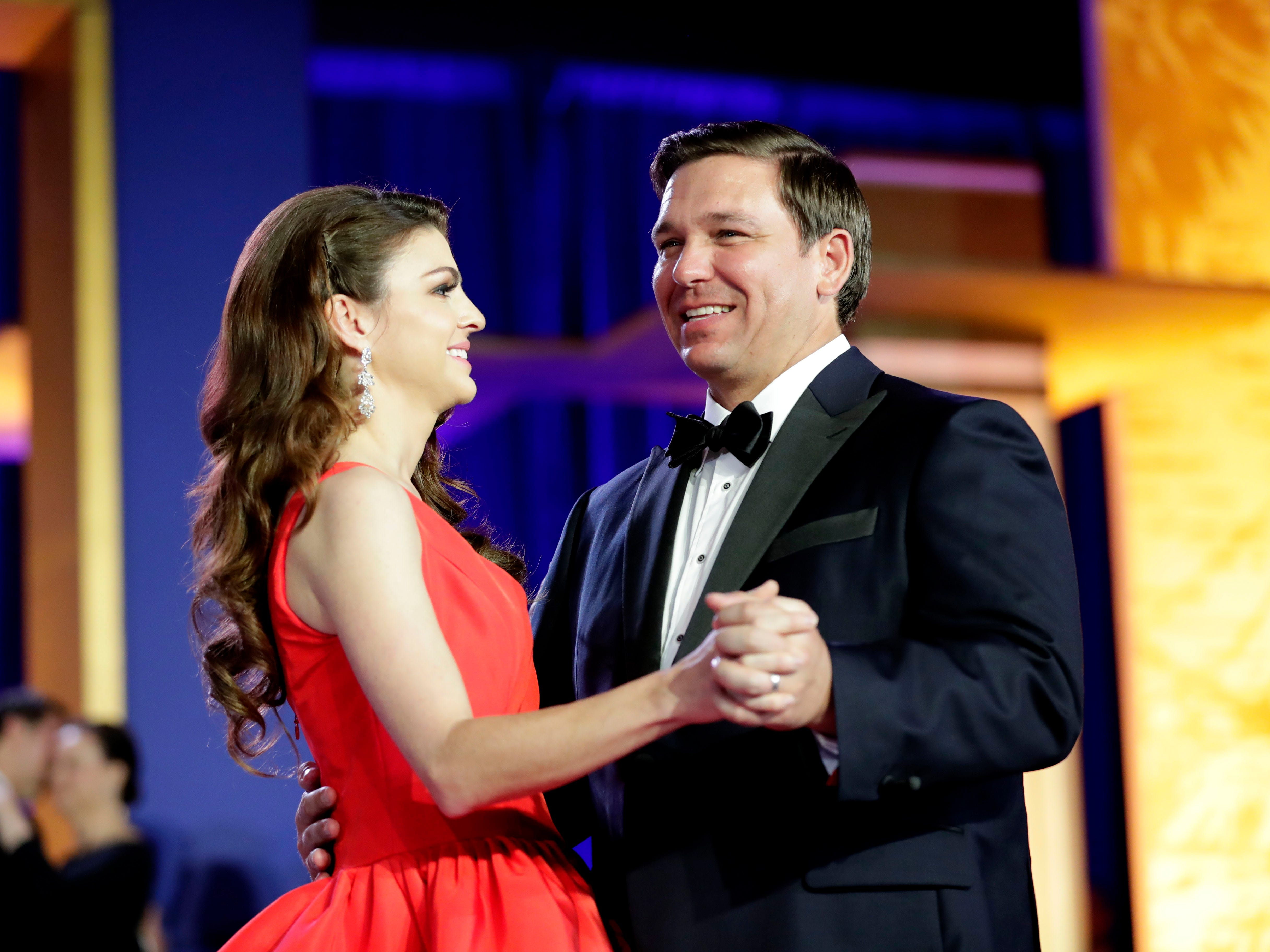 Hundreds of guests from all over Florida attend Florida's 46th Governor's Inaugural Ball at the Tucker Civic Center, Tuesday, Jan. 8, 2019. Gov. Ron DeSantis flashes a big smile as he dances with his wife, first lady Casey DeSantis.