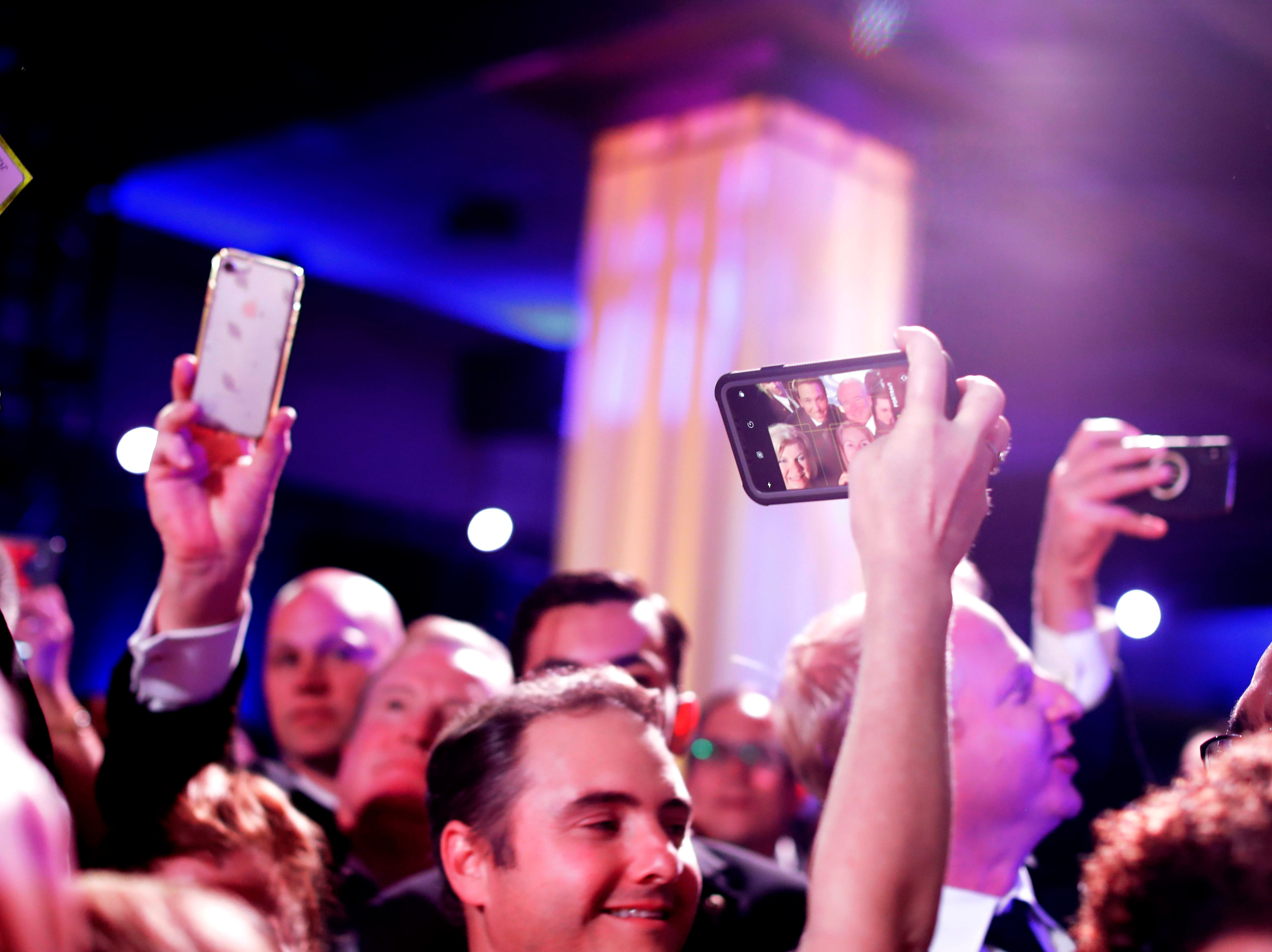 Hundreds of guests from all over Florida attend Florida's 46th Governor's Inaugural Ball at the Tucker Civic Center, Tuesday, Jan. 8, 2019. A guest takes a selfie with a group of friends and Gov. Ron DeSantis.