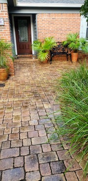 Attractive walkways help lead guest to the front door. A small patio at the door gives a place to mingle.