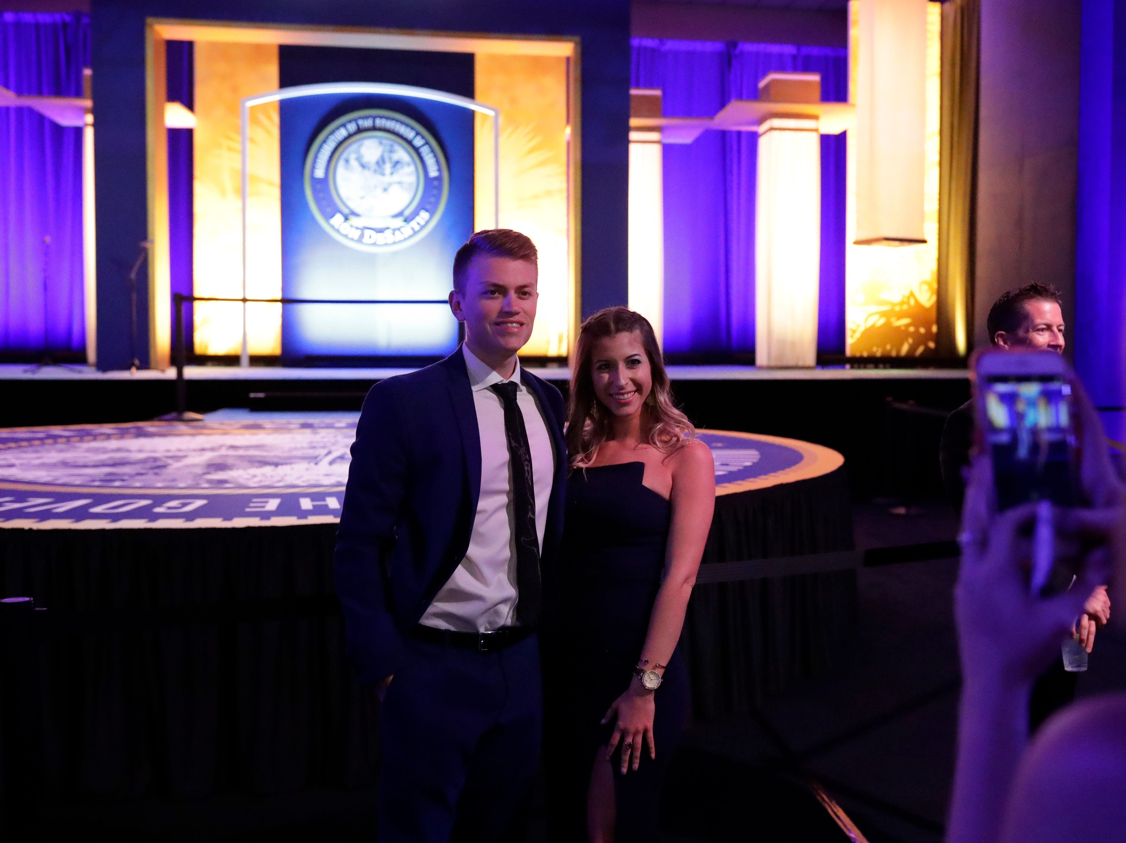 Hundreds of guests from all over Florida attend Florida's 46th Governor's Inaugural Ball at the Tucker Civic Center, Tuesday, Jan. 8, 2019. Guests pose for a photo in front of the main stage.