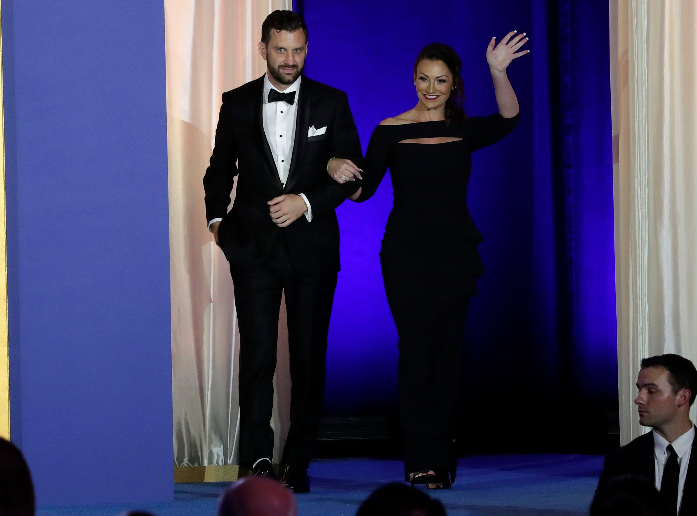Hundreds of guests from all over Florida attend Florida's 46th Governor's Inaugural Ball at the Tucker Civic Center, Tuesday, Jan. 8, 2019. Commissioner of Agriculture and Consumer Services Nikki Fried waves to the crowd as she is escorted onto the stage.