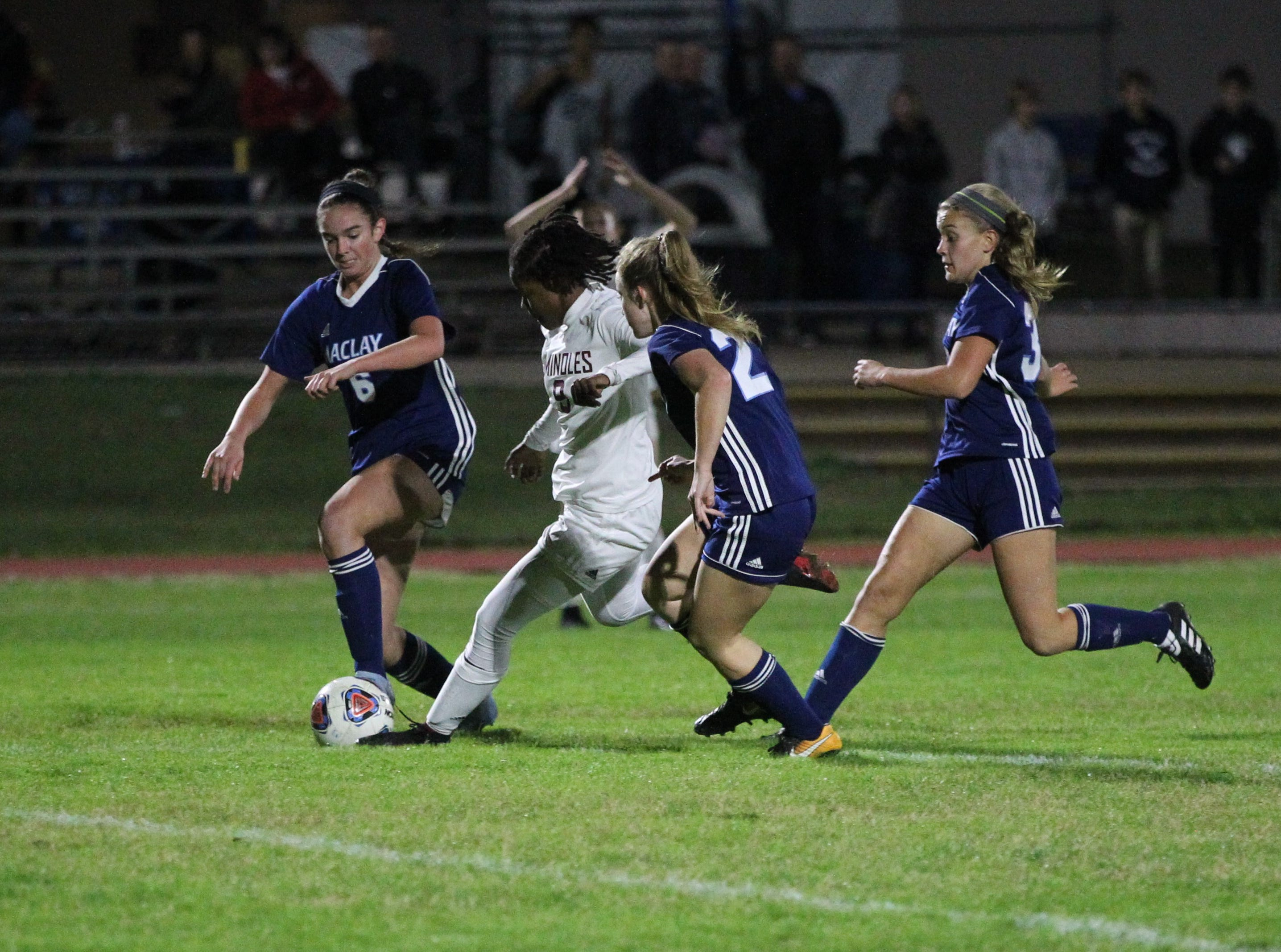 Florida High's Janae Scott takes a shot in between three defenders, but Maclay won 3-0 at home against Florida High on Jan. 8, 2019.