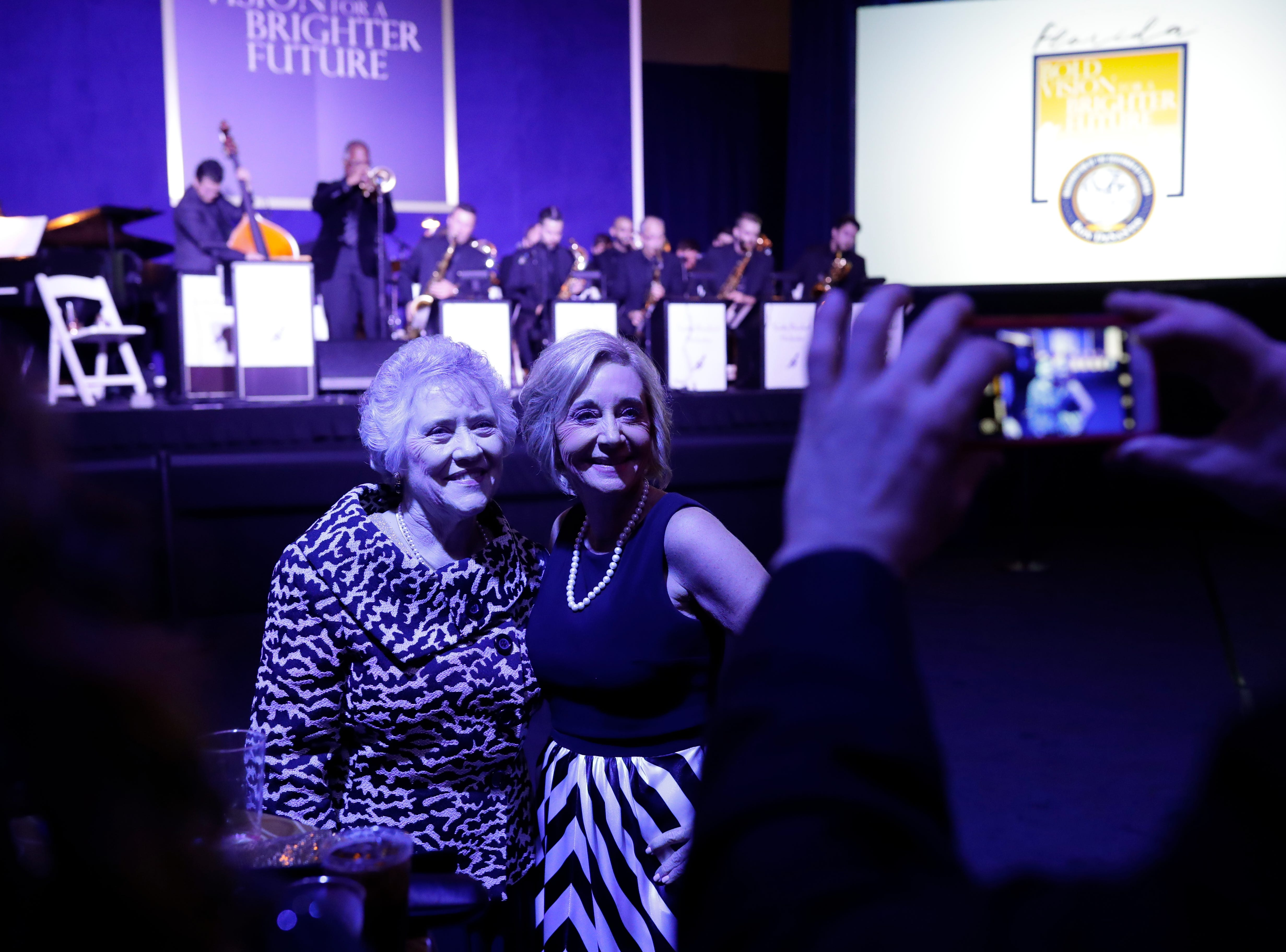 Hundreds of guests from all over Florida attend Florida's 46th Governor's Inaugural Ball at the Tucker Civic Center, Tuesday, Jan. 8, 2019. Guests pose for a photo in front of the musicians.
