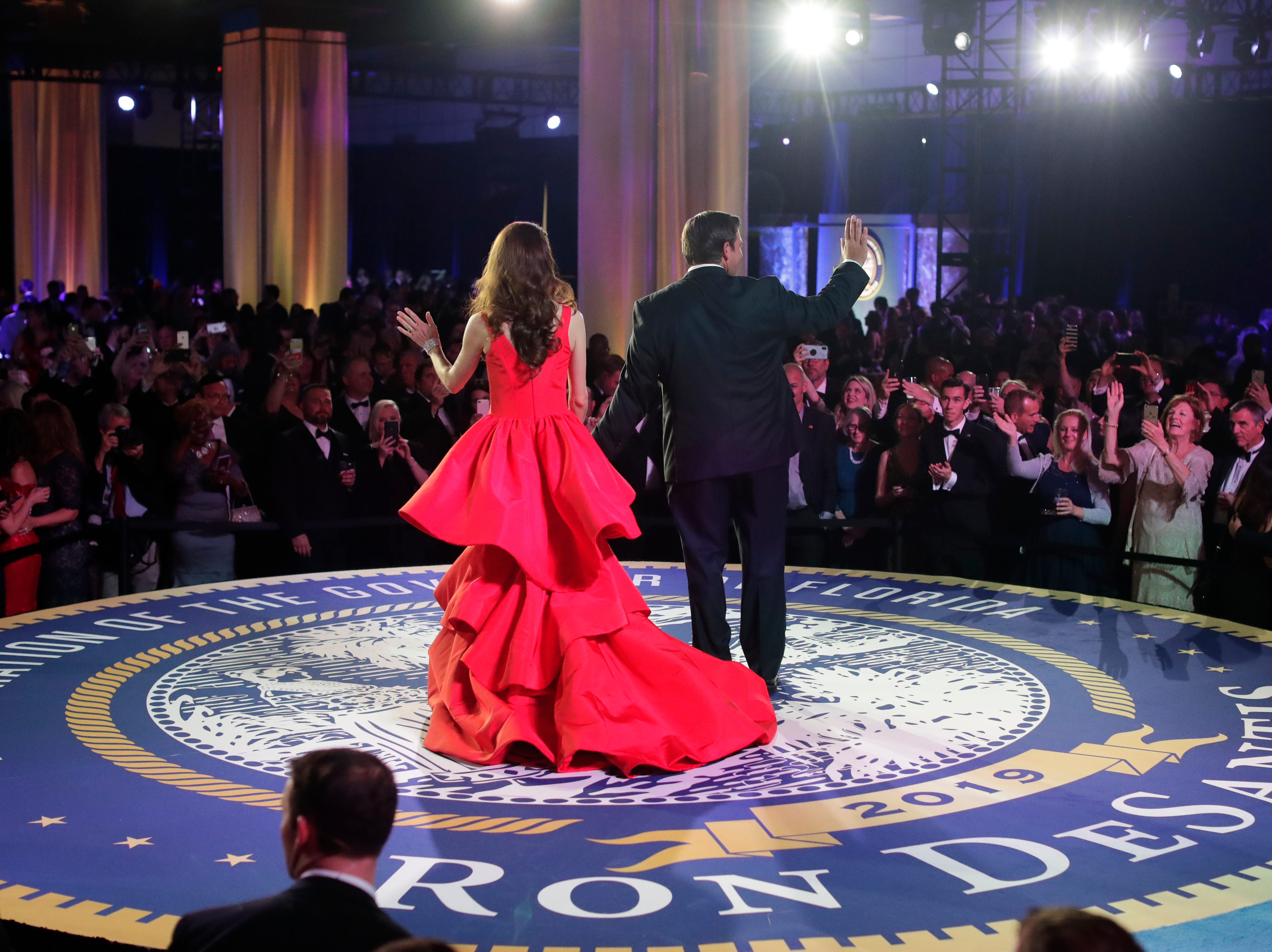Hundreds of guests from all over Florida attend Florida's 46th Governor's Inaugural Ball at the Tucker Civic Center, Tuesday, Jan. 8, 2019. First lady Casey DeSantis and Gov. Ron DeSantis wave to the crowd before exiting the stage.
