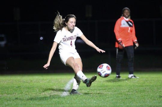 Florida High's Daphne Cervantes hits a goal kick as Maclay won 3-0 at home against Florida High on Jan. 8, 2019.