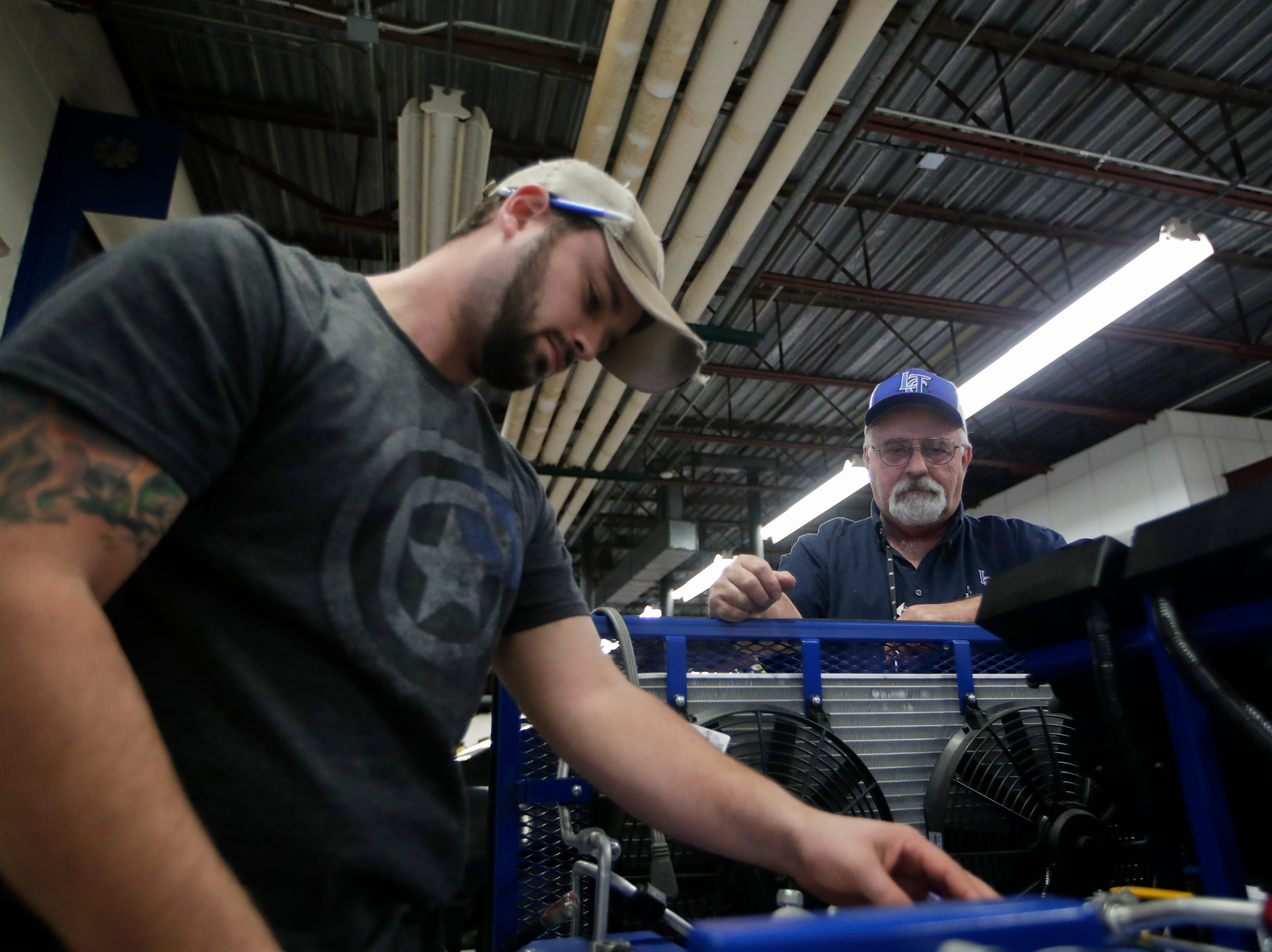 Automotive Service Technology Instructor Darrel Johnson watches as student Cody Smith works on the heating, ventilation and air conditioning model trainer Wednesday, Jan. 9, 2019 at Lively Technical Center which has been approved by the Leon County School Board to change it's name to Lively Technical College.