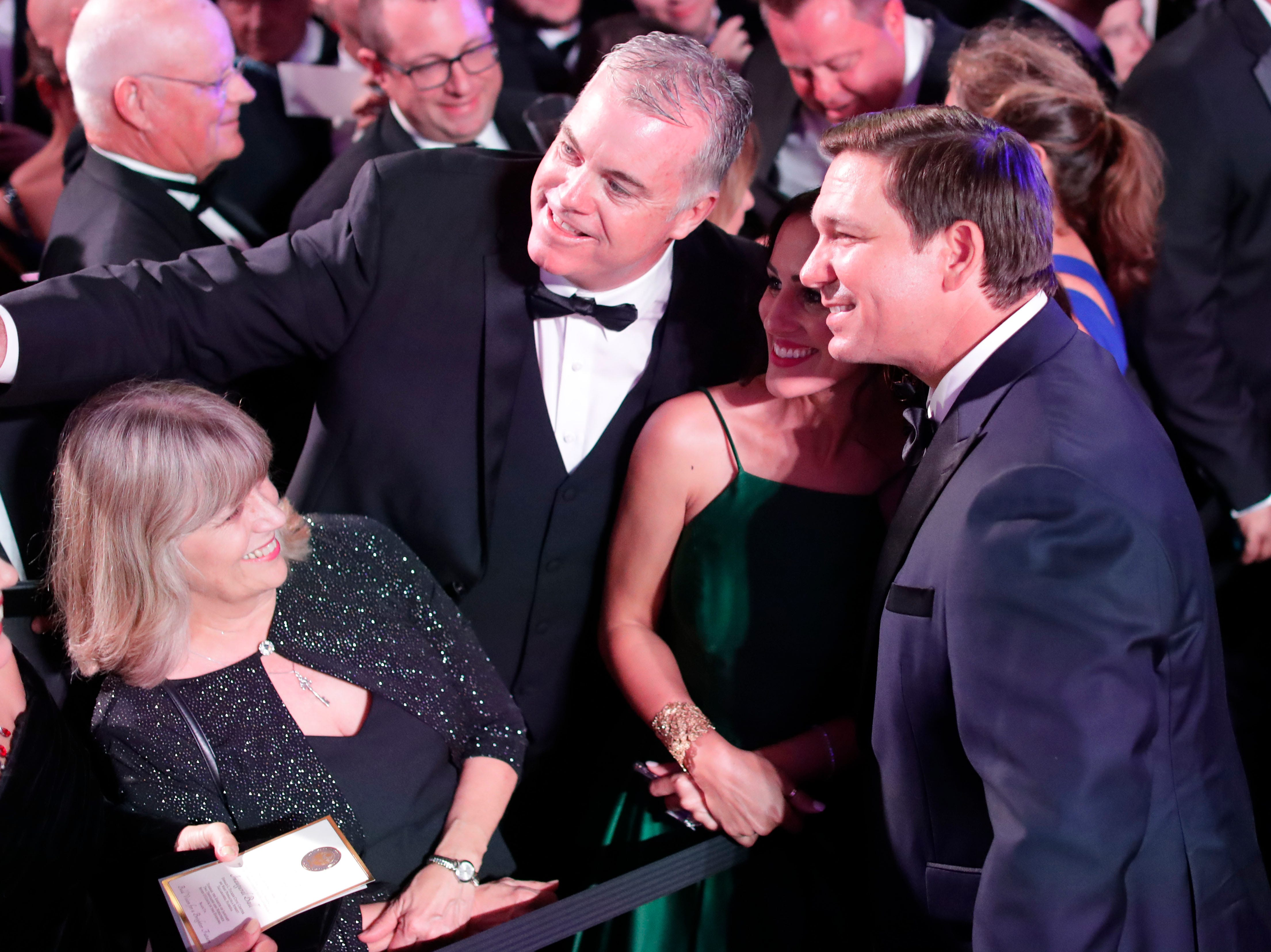 Hundreds of guests from all over Florida attend Florida's 46th Governor's Inaugural Ball at the Tucker Civic Center, Tuesday, Jan. 8, 2019. Gov. Ron DeSantis poses for a photo with guests.