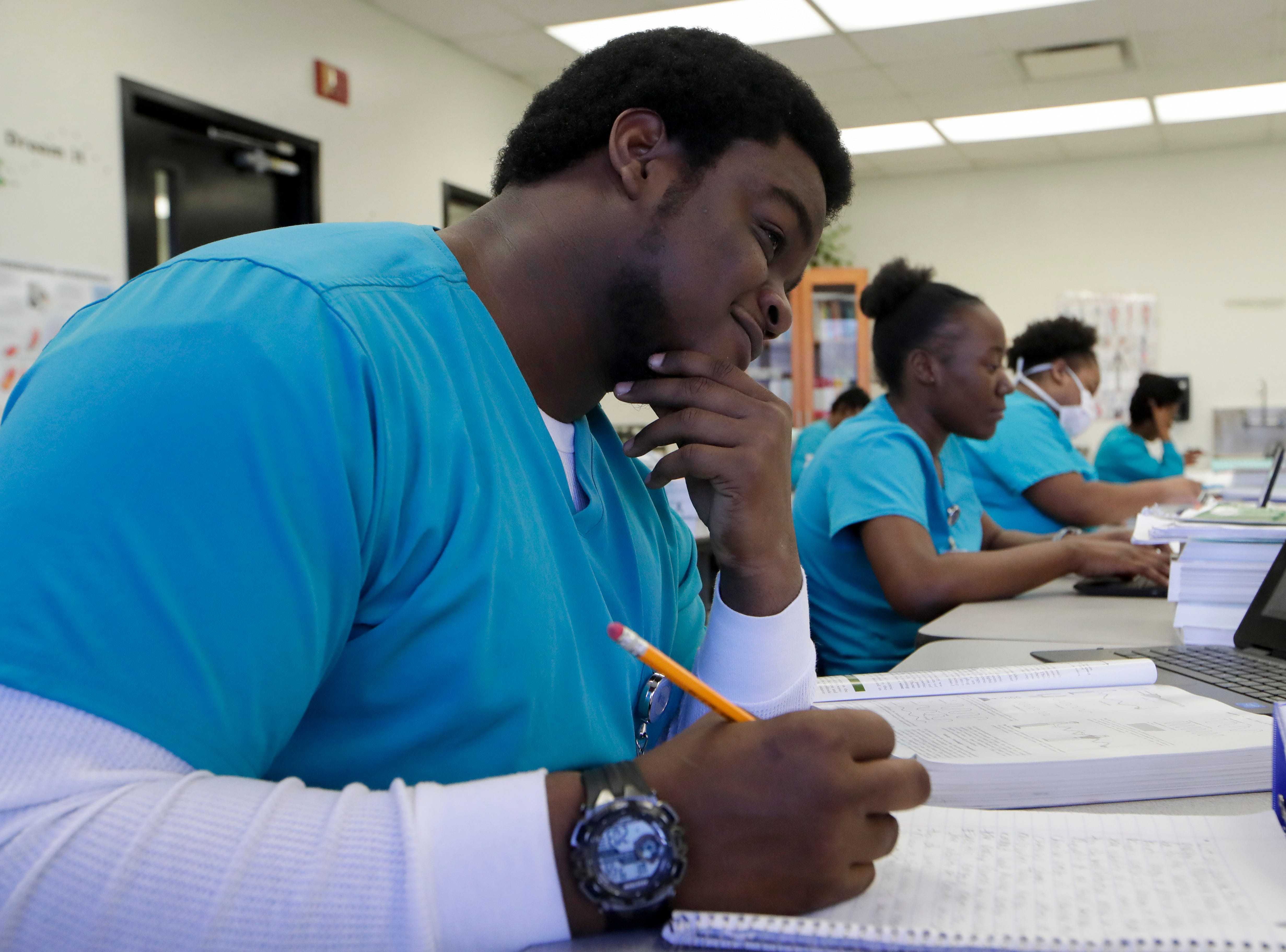 Medical assistant student Levonte White takes notes in class Wednesday, Jan. 9, 2019 at Lively Technical Center which has been approved by the Leon County School Board to change it's name to Lively Technical College.