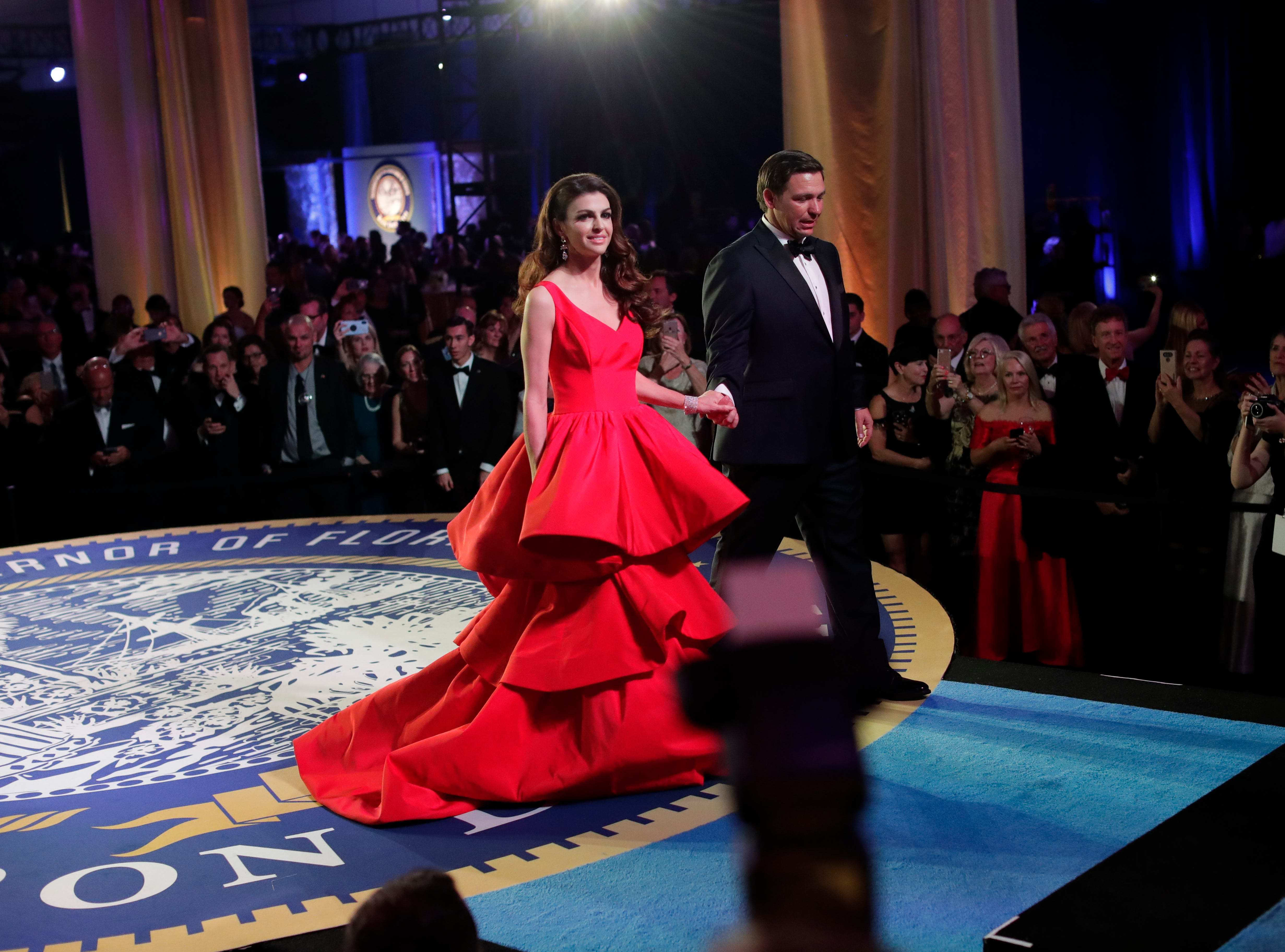 Hundreds of guests from all over Florida attend Florida's 46th Governor's Inaugural Ball at the Tucker Civic Center, Tuesday, Jan. 8, 2019. First lady Casey DeSantis and Gov. Ron DeSantis exit the stage after meeting with guests.