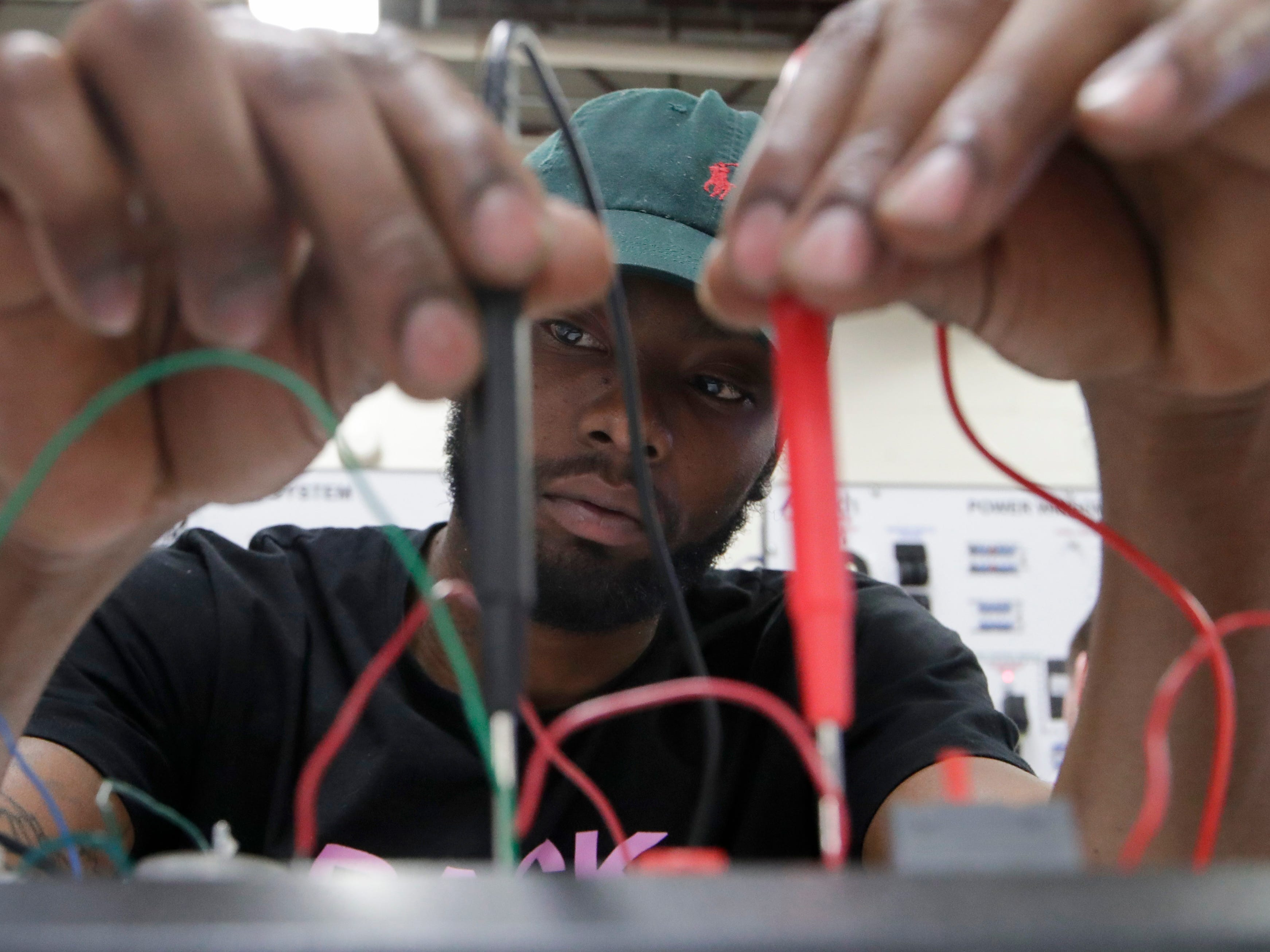 Automotive service technology program student Lothario Washington uses a circuits model trainer Wednesday, Jan. 9, 2019 at Lively Technical Center which has been approved by the Leon County School Board to change it's name to Lively Technical College.