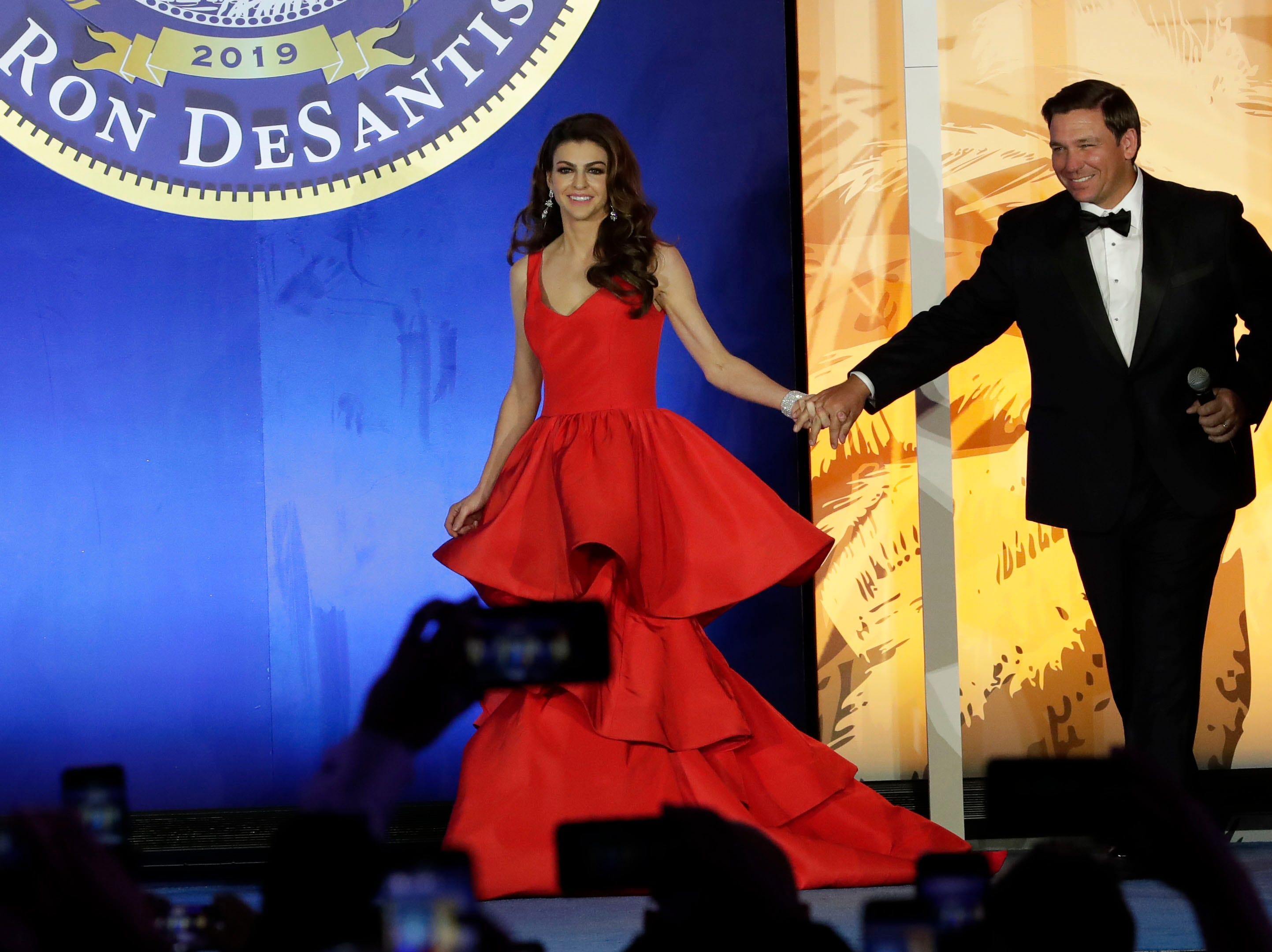 Hundreds of guests from all over Florida attend Florida's 46th Governor's Inaugural Ball at the Tucker Civic Center, Tuesday, Jan. 8, 2019. First lady Casey DeSantis, left, is escorted on stage by her husband, Gov. Ron DeSantis.