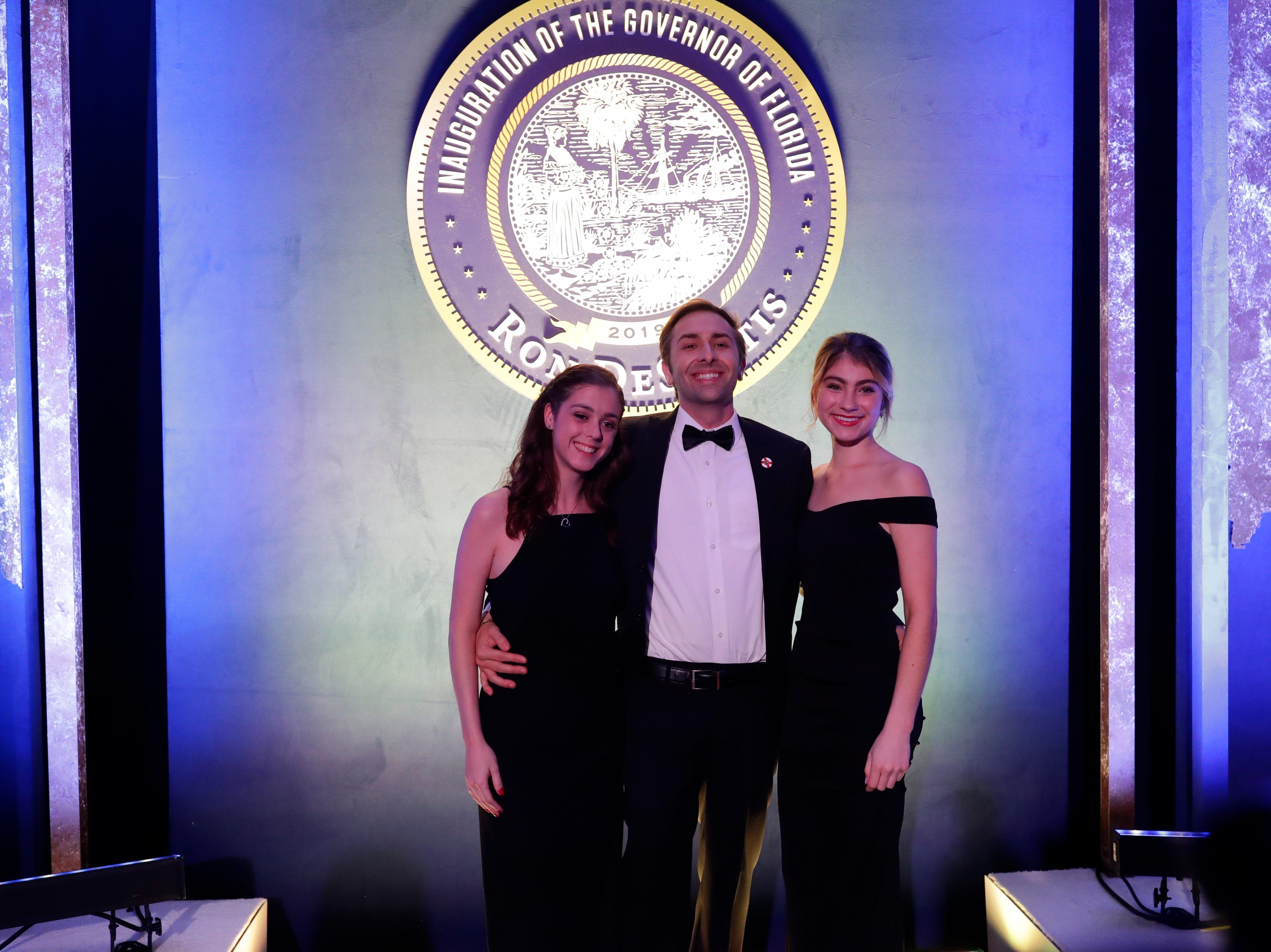 Hundreds of guests from all over Florida attend Florida's 46th Governor's Inaugural Ball at the Tucker Civic Center, Tuesday, Jan. 8, 2019. Guests have their photo taken in front of the DeSantis inauguration Florida state seal.