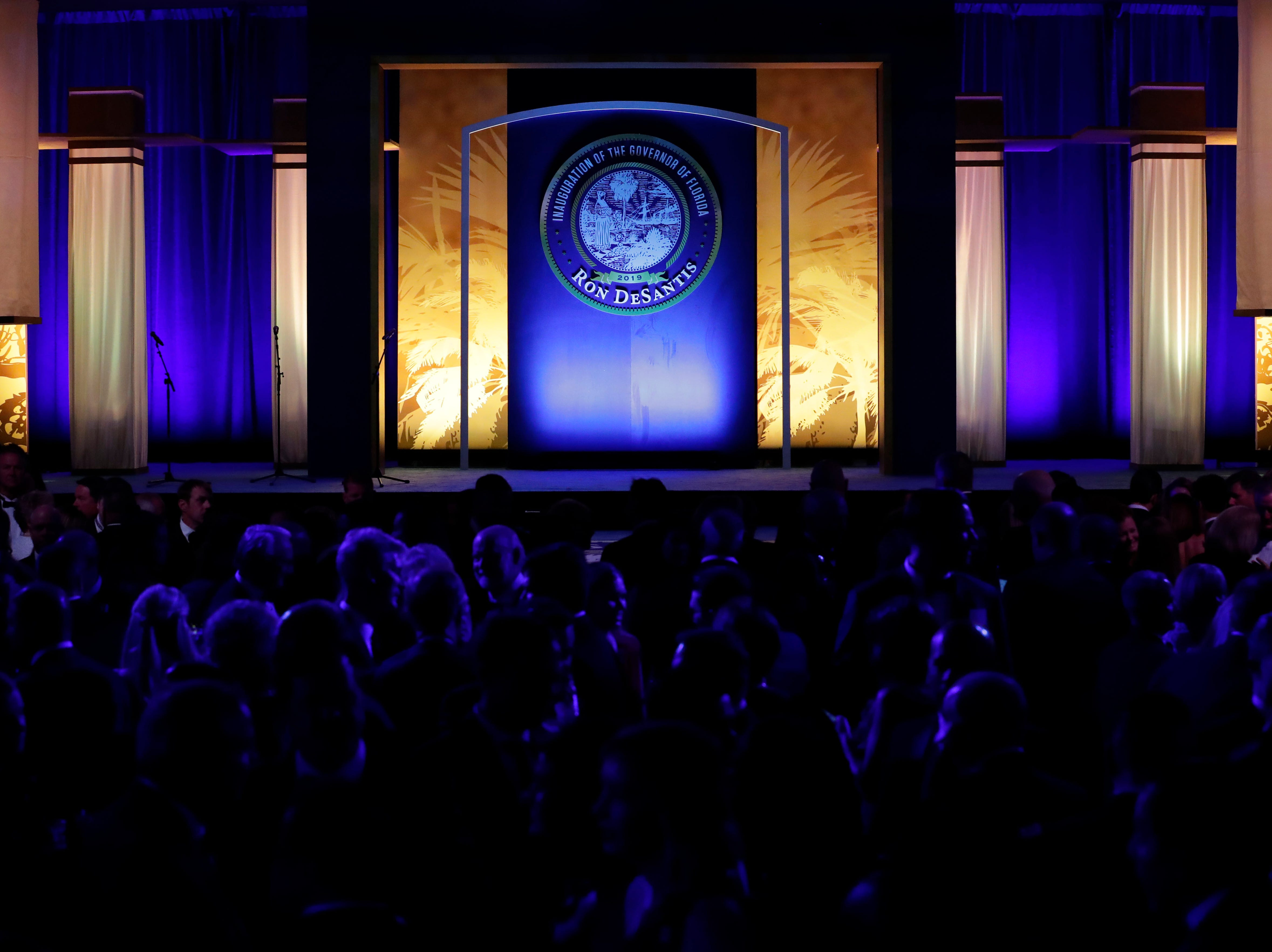 Hundreds of guests from all over Florida attend Florida's 46th Governor's Inaugural Ball at the Tucker Civic Center, Tuesday, Jan. 8, 2019. Guests begin to huddle around the stage as they await the arrival of Gov. Ron DeSantis.