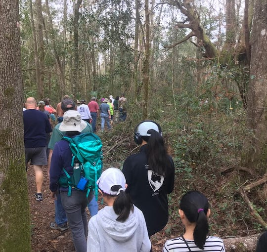 Line of Move walkers heading out on the trail.