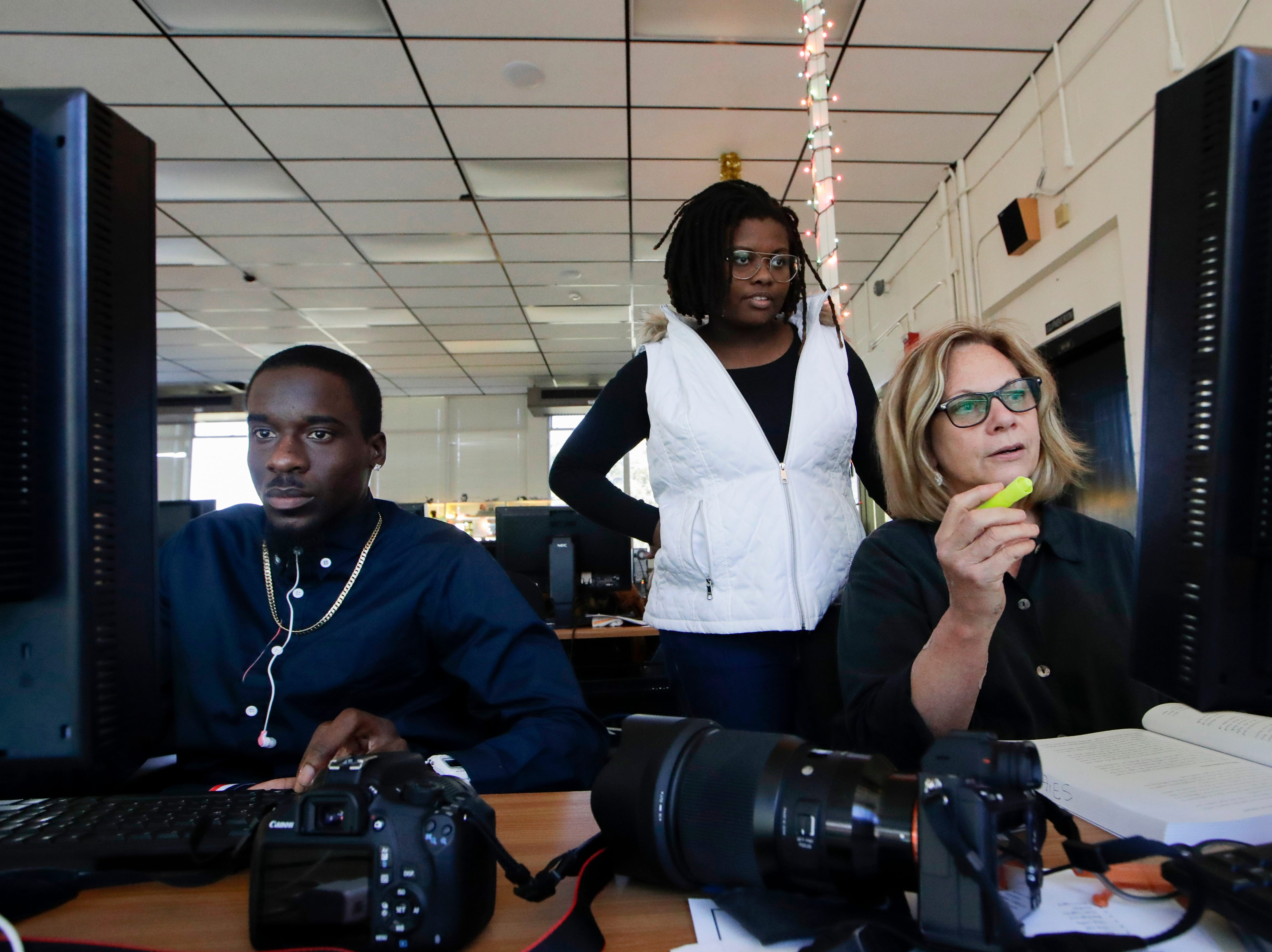 Photography students Shuntel Murray, Joi Berry and Mijnon Deshaies Wednesday, Jan. 9, 2019 at Lively Technical Center which has been approved by the Leon County School Board to change it's name to Lively Technical College.