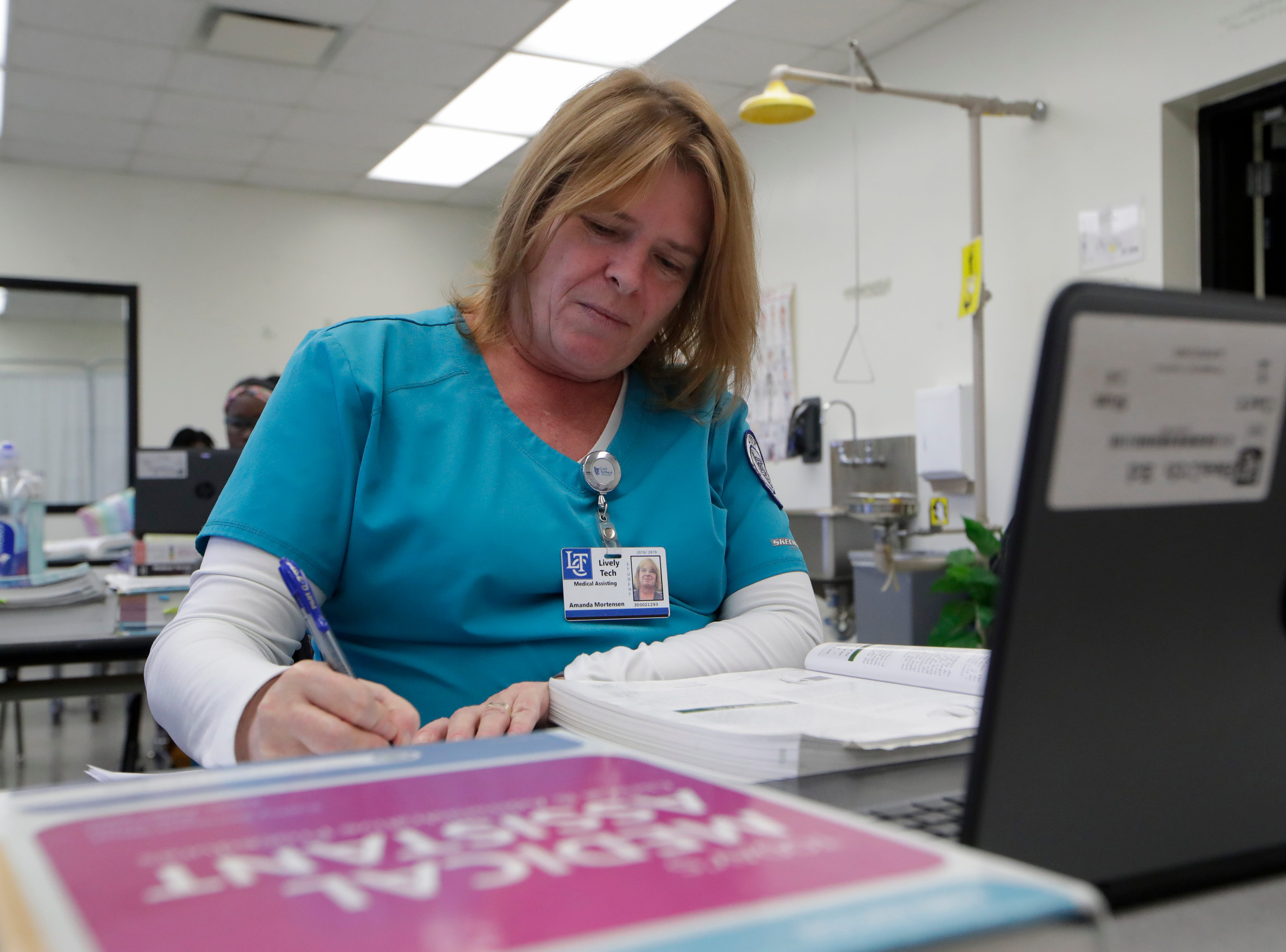 Medical assistant student Amanda Mortensen takes notes from a textbook Wednesday, Jan. 9, 2019 at Lively Technical Center which has been approved by the Leon County School Board to change it's name to Lively Technical College.