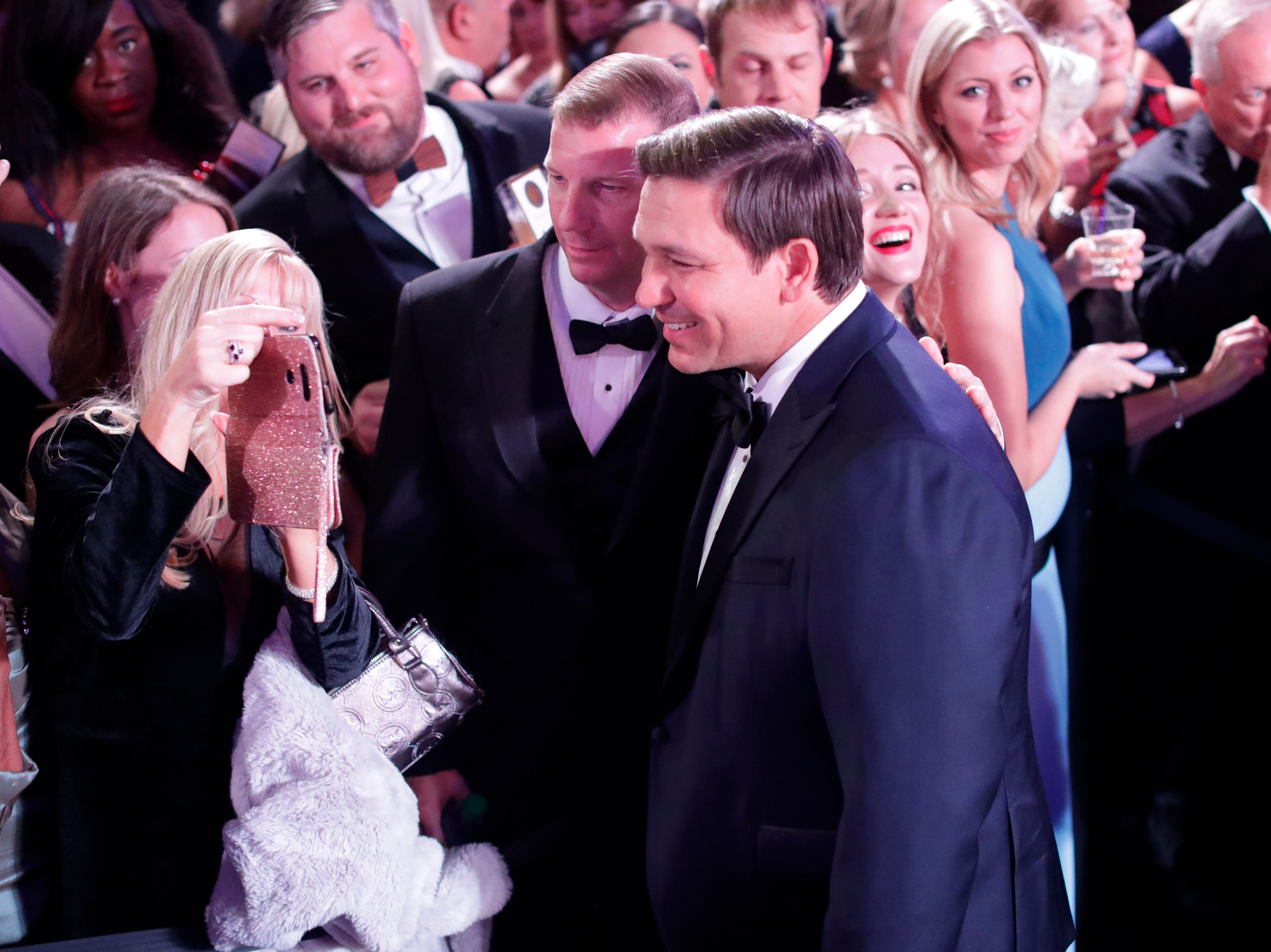 Hundreds of guests from all over Florida attend Florida's 46th Governor's Inaugural Ball at the Tucker Civic Center, Tuesday, Jan. 8, 2019. Gov. Ron DeSantis takes a photo with a guest at the ball.