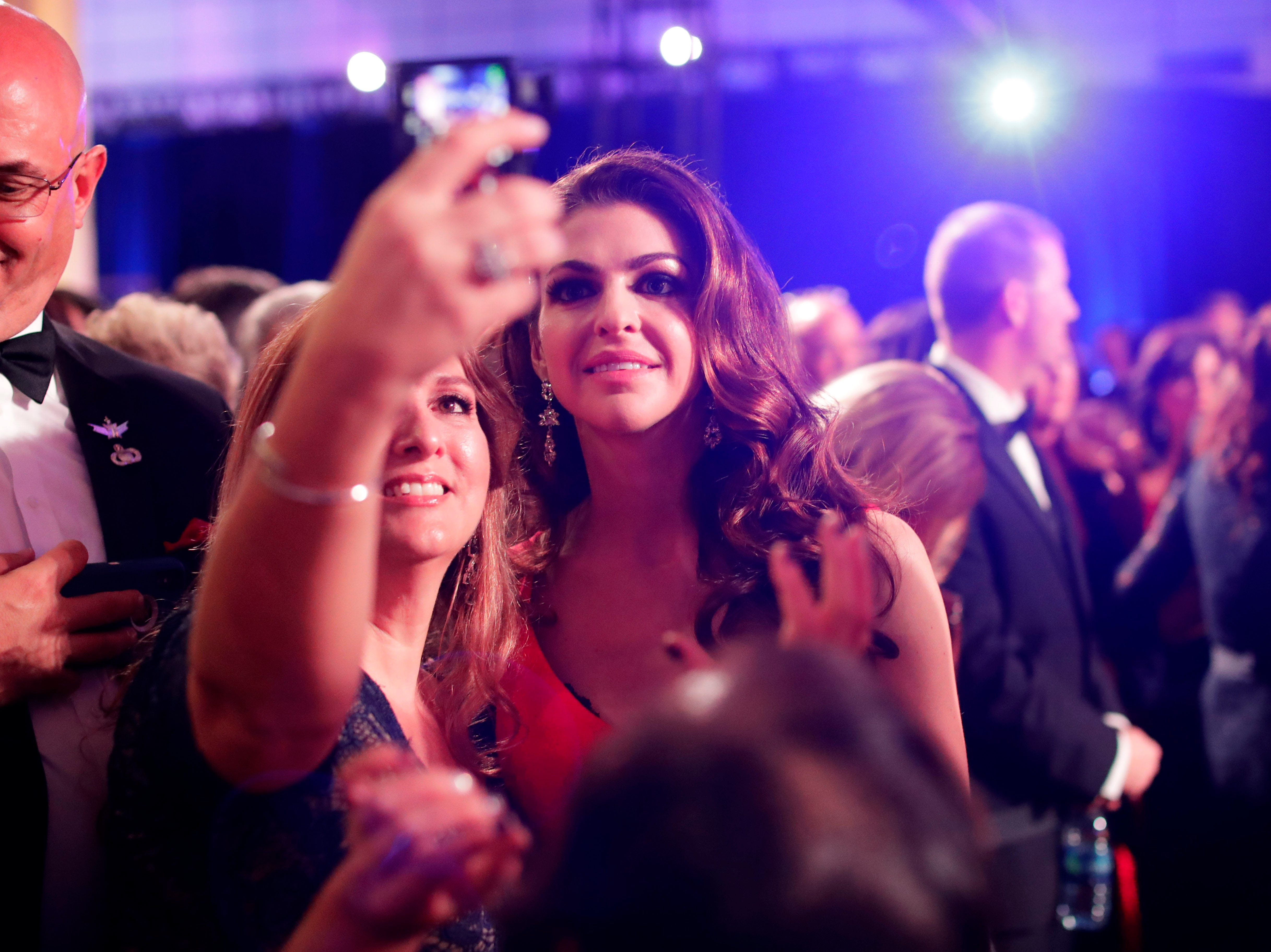 Hundreds of guests from all over Florida attend Florida's 46th Governor's Inaugural Ball at the Tucker Civic Center, Tuesday, Jan. 8, 2019. First lady, Casey DeSantis poses for a selfie with a guest.