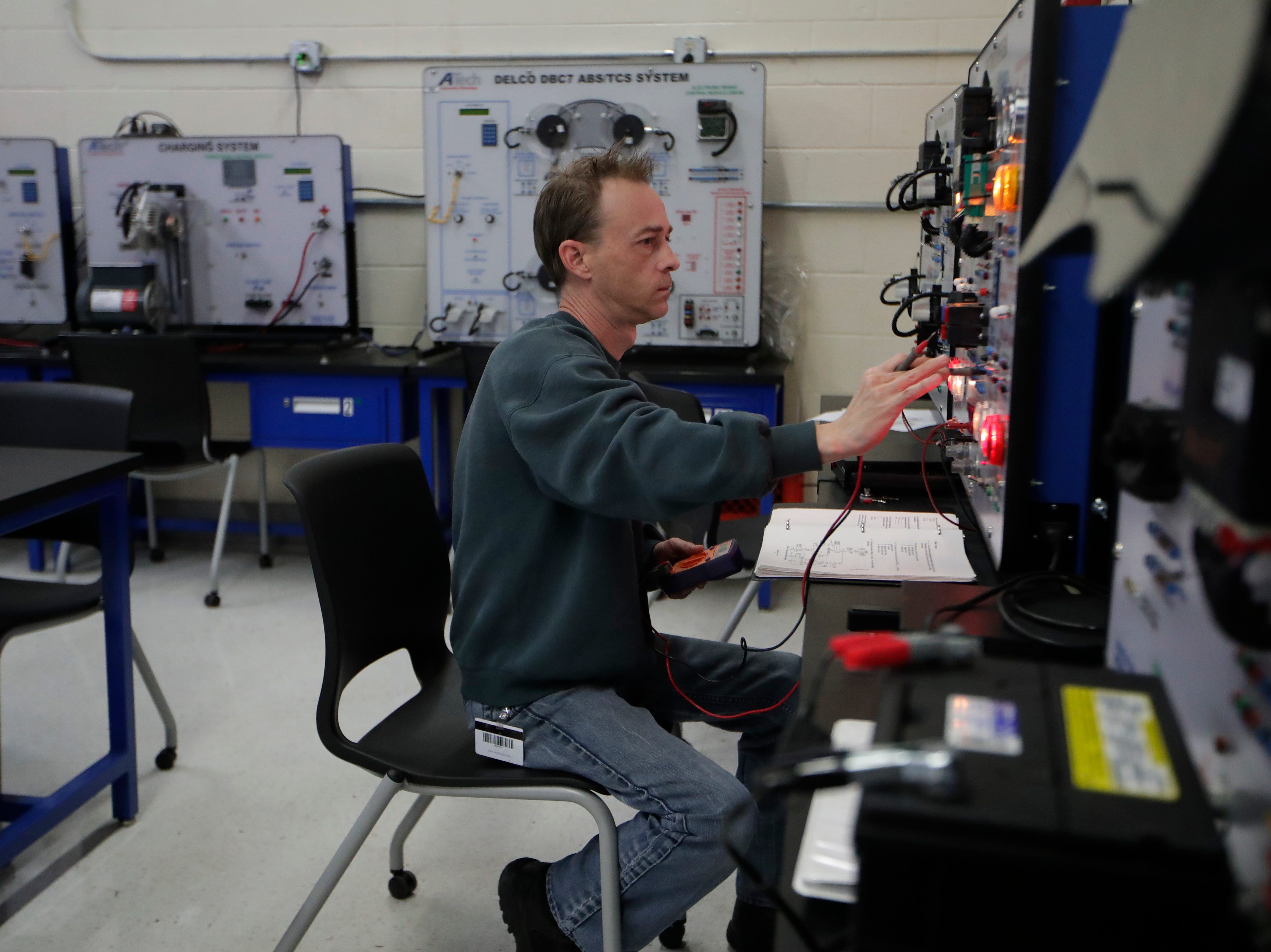 John Horne, an automotive services technology program student, works with a headlamp model trainer Wednesday, Jan. 9, 2019 at Lively Technical Center which has been approved by the Leon County School Board to change it's name to Lively Technical College.