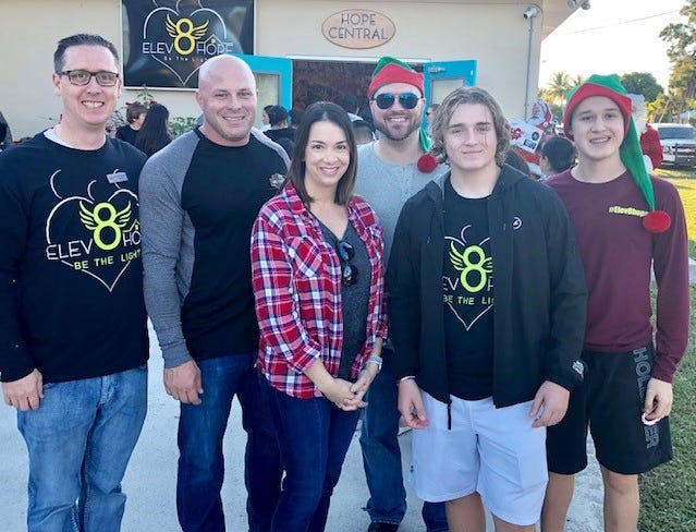 Elev8Hope's Community Christmas Toy Giveaway was made possible thanks to the efforts of Dr. Brian Moriarty, left, Peter DelToro, Jaclyn Uhl , Peter Sicoli , and Elev8Hope Student co-Founders Trevor Shpiruk and Mitchell Shpiruk.