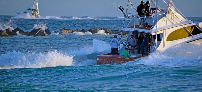 The Kickin Tires and other boats leave the Fort Pierce Inlet Wednesday on the first day of fishing in the Pelican Yacht Club Billfish Invitational.