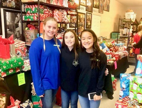 Sarah Ward, left, Julia Jocks and Elev8hope Co-Founder Myah Shpiruk at the Community Christmas Toy Giveaway held at Hope Central in Stuart on Dec. 22.