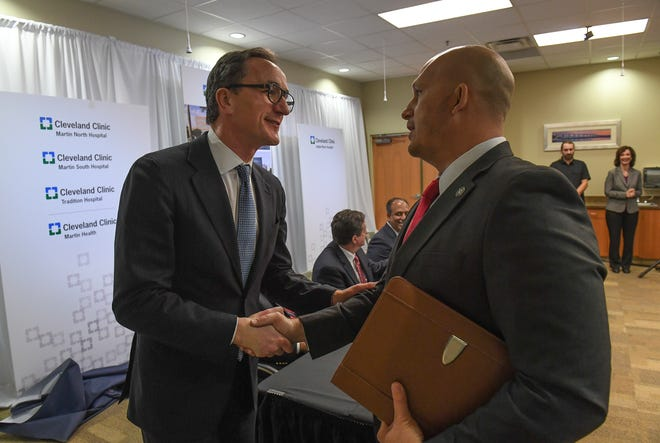 """Tom Mihaljevic, M.D., (left) Cleveland Clinic CEO and President, expresses his gratitude with City of Port St. Lucie Mayor Gregory Oravec, after Oravec delivered a speech welcoming Cleveland Clinic to Port St. Lucie, declaring Wednesday, Jan. 9, 2019, Cleveland Clinic Day in Port St. Lucie, during a news conference at Tradition Hospital. """"It feels great,"""" Mihaljevic said. """"It's really a great opportunity for us here in Florida and we're very excited. We've been warmly welcomed and we're very excited to extending our services to as many Floridians as we can."""" The new names are Cleveland Clinic Martin North Hospital, Cleveland Clinic Martin South Hospital, Cleveland Clinic Tradition Hospital, Cleveland Clinic Martin Health and Cleveland Clinic Indian River Hospital."""