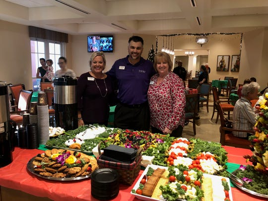 Thanks to event sponsor Trilogy Home Health Care, the event raised $350 for Elev8Hope and brought smiles to the faces of many who seniors who enjoyed trimming their Christmas tree. Pictured are Dawn Ankney, left, Joe Patton and Patricia Gross.