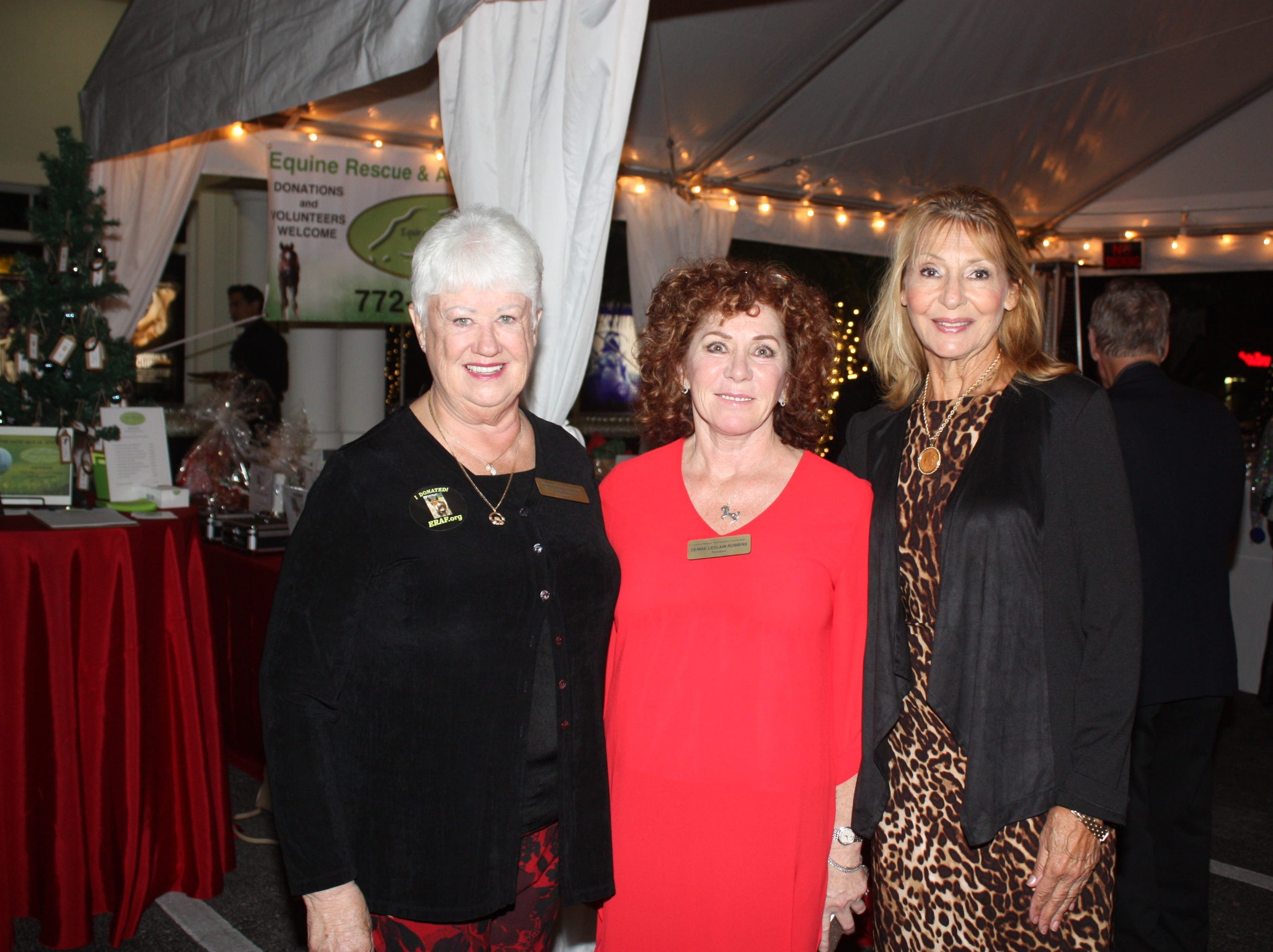 Marilynn Vannucci, left, Denise LeClair-Robbins and Dolores Kennedy at the Provident Jewelry party for the Equine Rescue and Adoption Foundation.