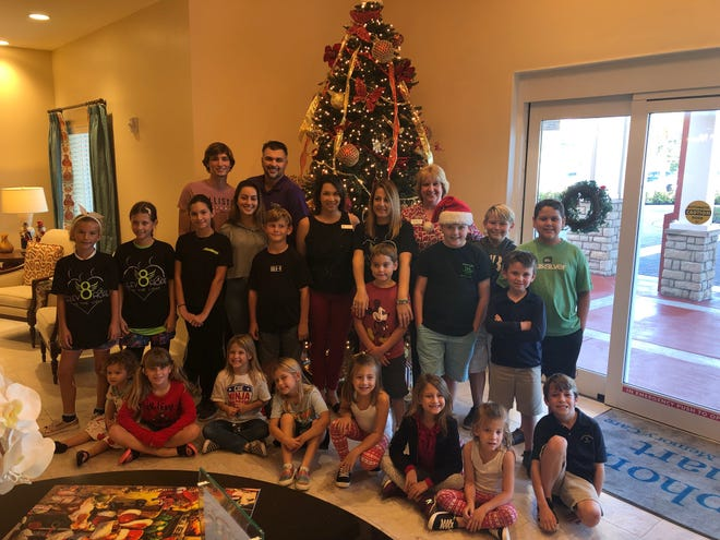 """Day of Hope was a charitable community event that brought children and seniors together over the holidays to paint ornaments and decorate a Christmas tree that was on display at the Symphony of Stuart for all residents to enjoy. The children were from Elev8Hope, a nonprofit that teaches children how to """"pay it forward."""""""