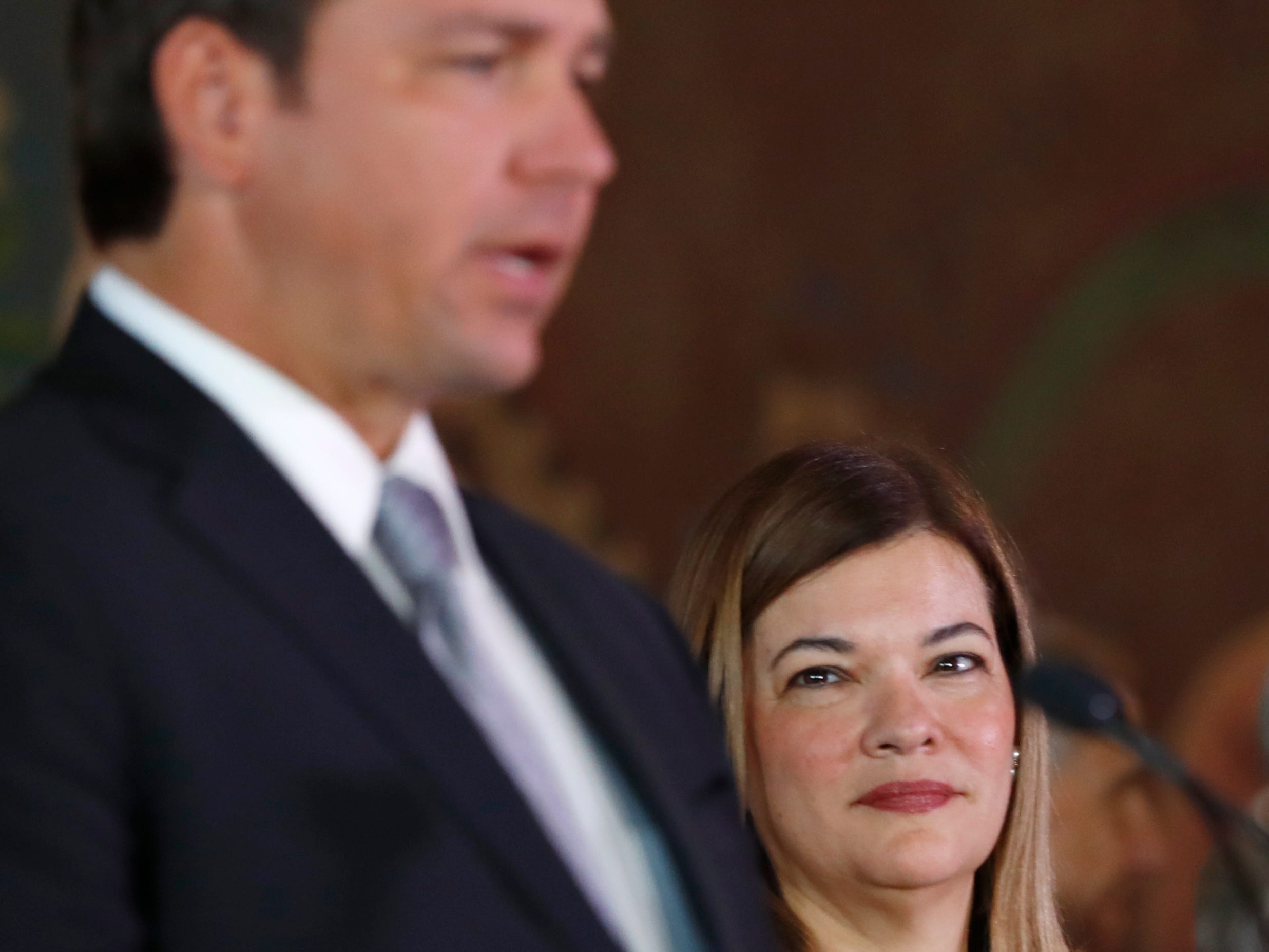 Barbara Lagoa, right, looks on as Governor Ron DeSantis introduces her as his pick for the Florida Supreme Court, Wednesday, Jan. 9, 2019, in Miami.