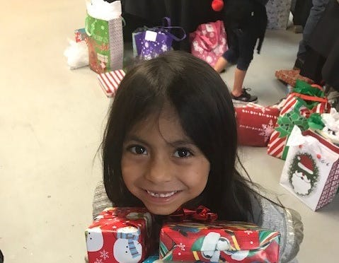 Elev8Hope's Community Christmas Toy Giveaway  blessed 500 families. Children were allowed to make gift selections from tables filled with wrapped toys sorted into age groups and gender.