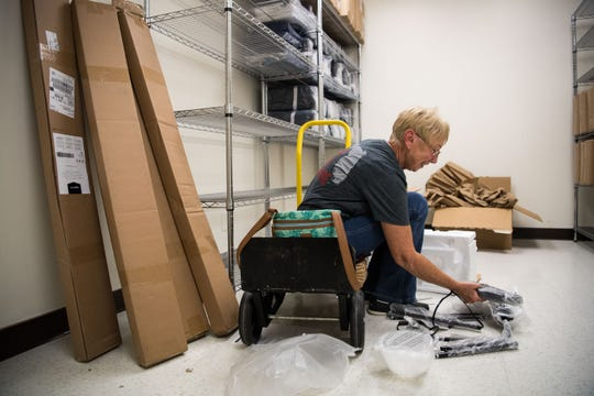 """Carol Berry, of Port St. Lucie, assembles lamps at The Salvation Army's Adam's Place, a men's jail diversion/prevention and veterans intervention homeless shelter, on Tuesday, Jan. 8, 2019, at 609 N. 7th St. in Fort Pierce. Berry was working with a group of mission volunteers from Christ Fellowship Church in Port St. Lucie to help prepare Adam's Place ahead of a dedication ceremony and open house Jan. 17, and planned opening to begin sheltering men Jan. 21. """"We also work with a group called Sarah's Kitchen,"""" Berry said, referring to volunteer work she and her husband do where they encounter many people in the area who are homeless. """"It's tragic — some of them are there by choice, and some by circumstance,"""" she added. """"It's a tough world, they get hassled wherever they go, so having this as an alternative…is really, really a good thing."""""""
