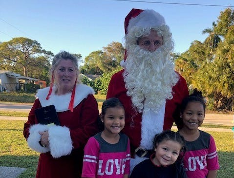 Santa and Mrs. Claus made an appearance at Elev8Hope's Community Christmas Toy Giveaway at 3700 S.E. Salerno Road in Stuart on Dec. 22.