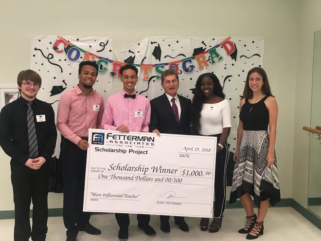 2018 Fetterman & Associates Scholarship Winners, from left, Austin Nelson of Indian River Charter High School, Dylan Melville of A.W. Dreyfoos School of the Arts, Michael Nunez of Inlet Grove Community High School, Evan Fetterman, Janae Steen of Pahokee Middle Senior High School and Devin Stanley of Vero Beach High School.