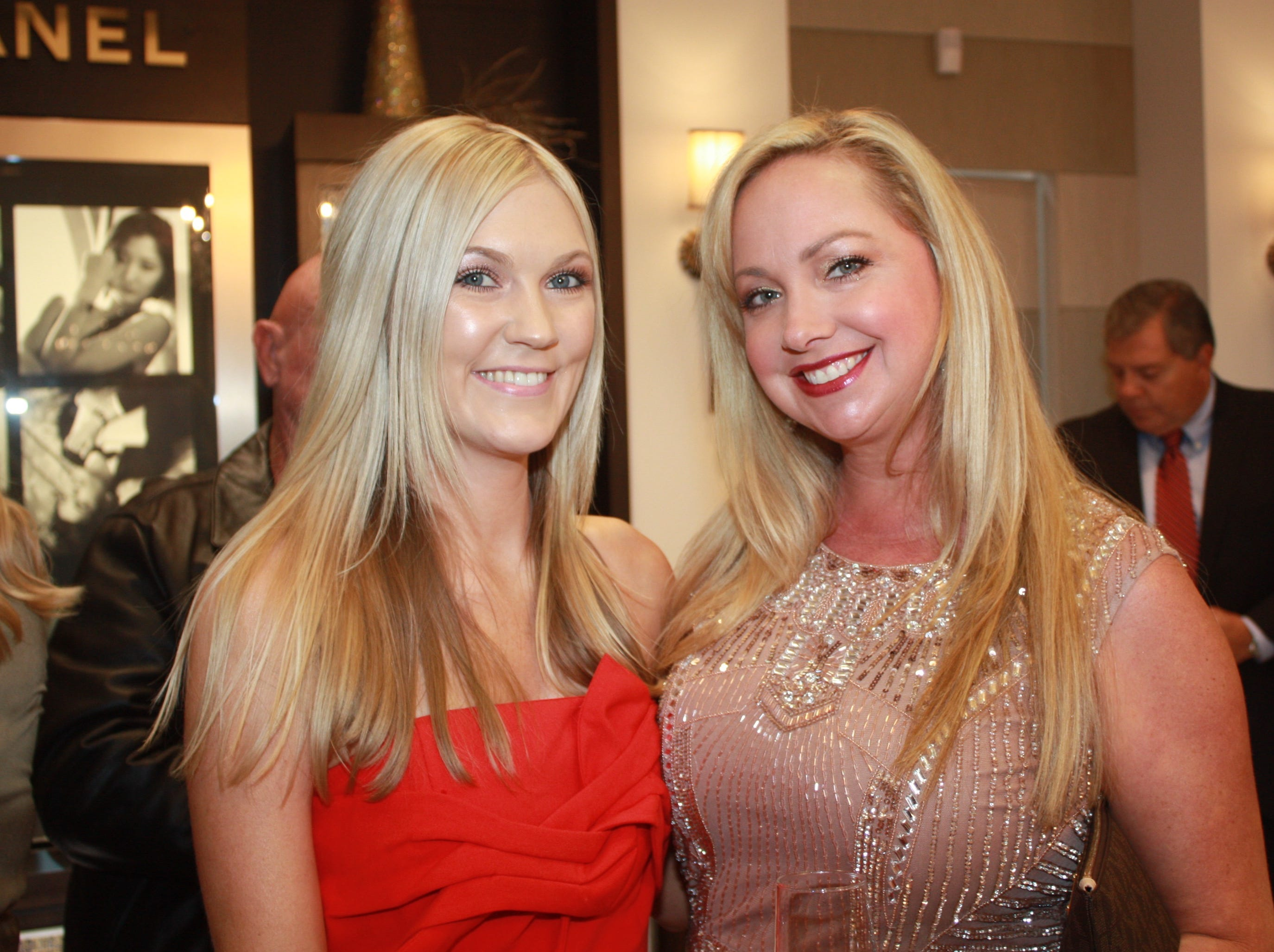 Hailey Linca, left, and Jaime Gonzalez sparkle at the Provident Jewelry party for the Equine Rescue and Adoption Foundation.
