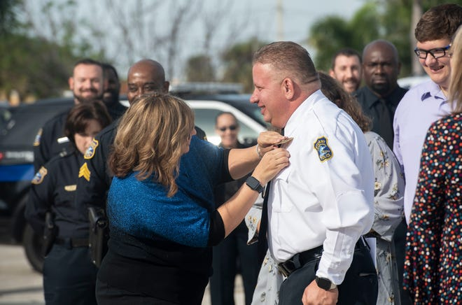 "Stuart Police Chief Joseph Tumminelli (right) receives his new badge from his wife Martiza Tumminelli, with the support of their children, Hailey Tumminelli and Ryan Tumminelli, during Chief Tumminelli's swearing-in ceremony Wednesday, Jan. 9, 2019, at the Stuart Police Department. Former chief David Dyess, now Stuart's city manager, appointed Tumminelli, who has been with the department since 1997, to chief in December. ""To the community, I will provide the best customer service to people in need,"" Tumminelli said during his address to the crowd that featured his friends and family, the Stuart City Commission, other area police chiefs and local dignitaries."