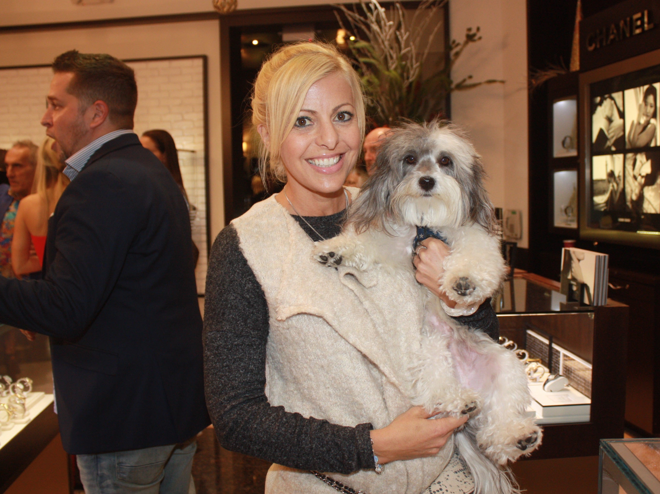 Nicole Haboush with her dog Maximillian at the Provident Jewelry party for the Equine Rescue and Adoption Foundation.